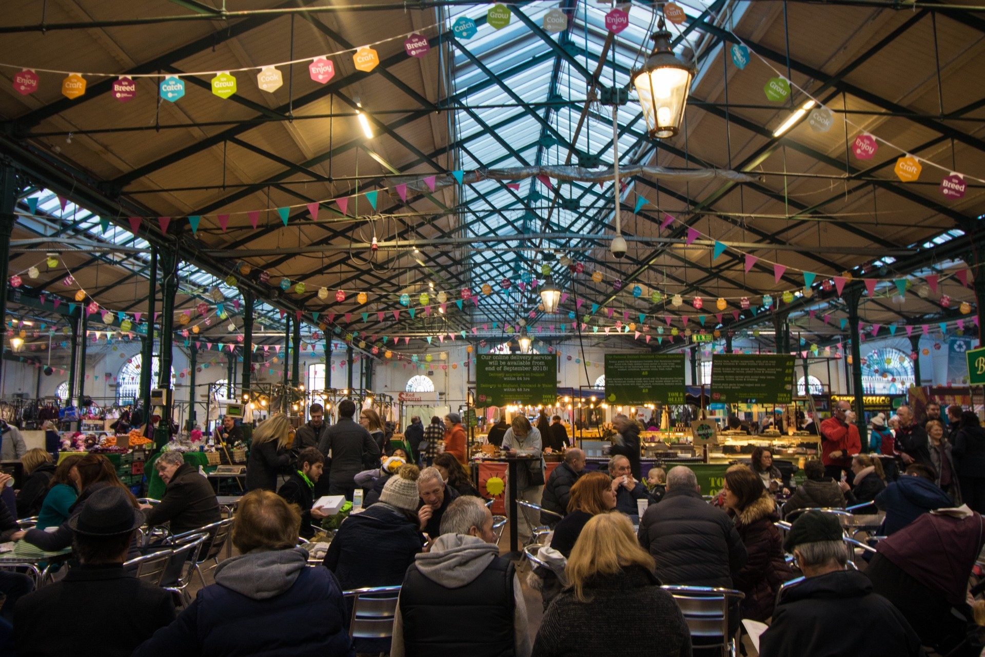 st-georges-market-hall-with-bunting-on-the-ceiling-filled-with-lots-of-people-eating-breakfast