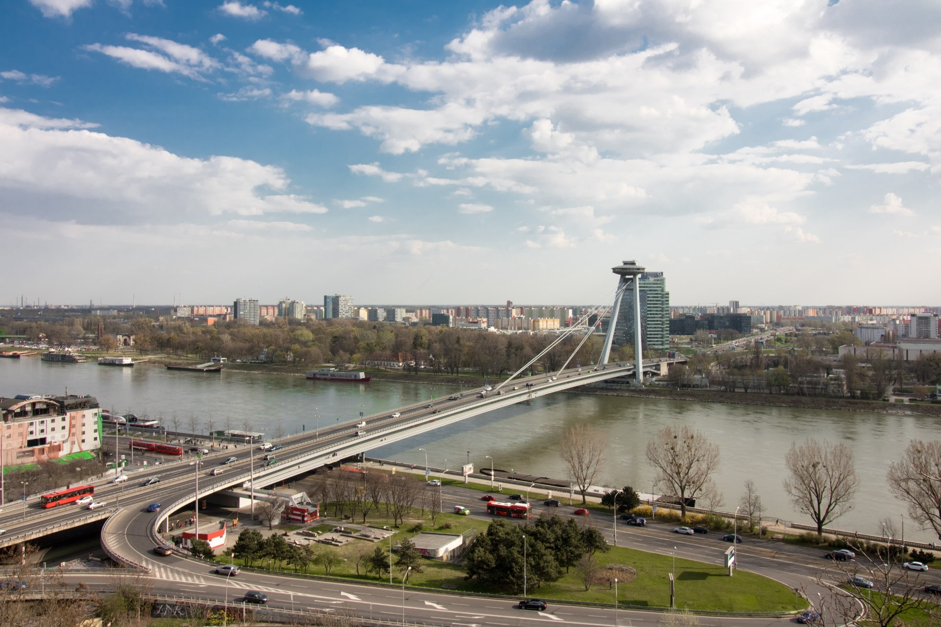 view-from-bratislava-castle-across-to-UFO-observation-deck-on-top-of-a-main-road-running-across-a-bridge-across-the-river-one-day-in-bratislava