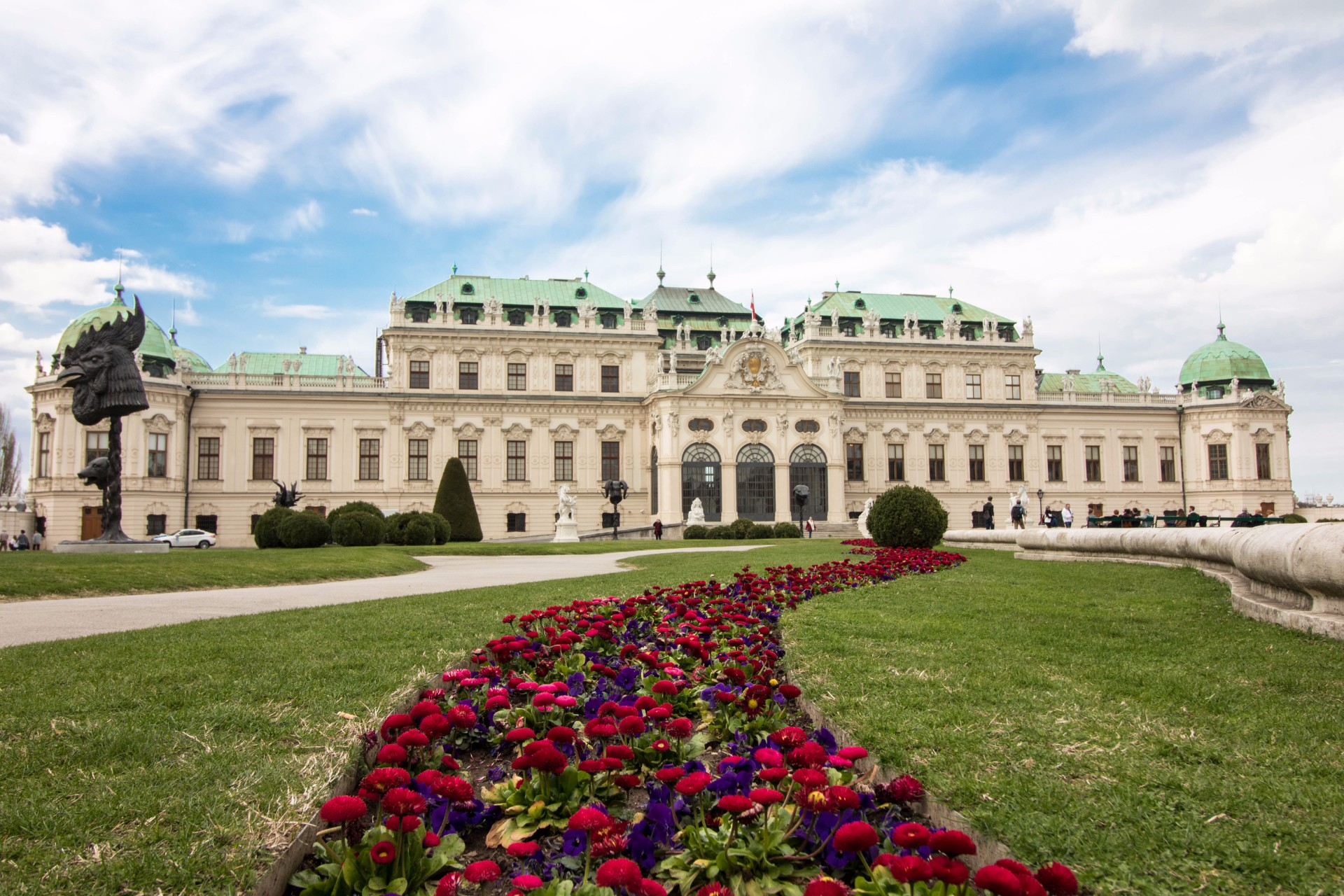 Belvedere Museum. Historical European museum and grand palace with a turquoise roof with beautiful red flower gardens and trees in front. 9 Amazing Places to Visit in Vienna, Austria. What to do in Vienna. Things to do in Vienna. Vienna sightseeing. Vienna attractions. Vienna top attractions. Vienna travel blog. Vienna travel guide. What to see in Vienna. Things to see in Vienna. Vienna tourism. Vienna tourist attractions. Vienna points of interest. Visit Vienna. Schönbrunn Palace. Schonburnn Palace. St. Stephen's Cathedral. Hundertwasser Village. Votive Church. Belvedere Museum. Prater Park. Museumsquartier. Hofburg Palace. Stadt Park. Click through to read more...