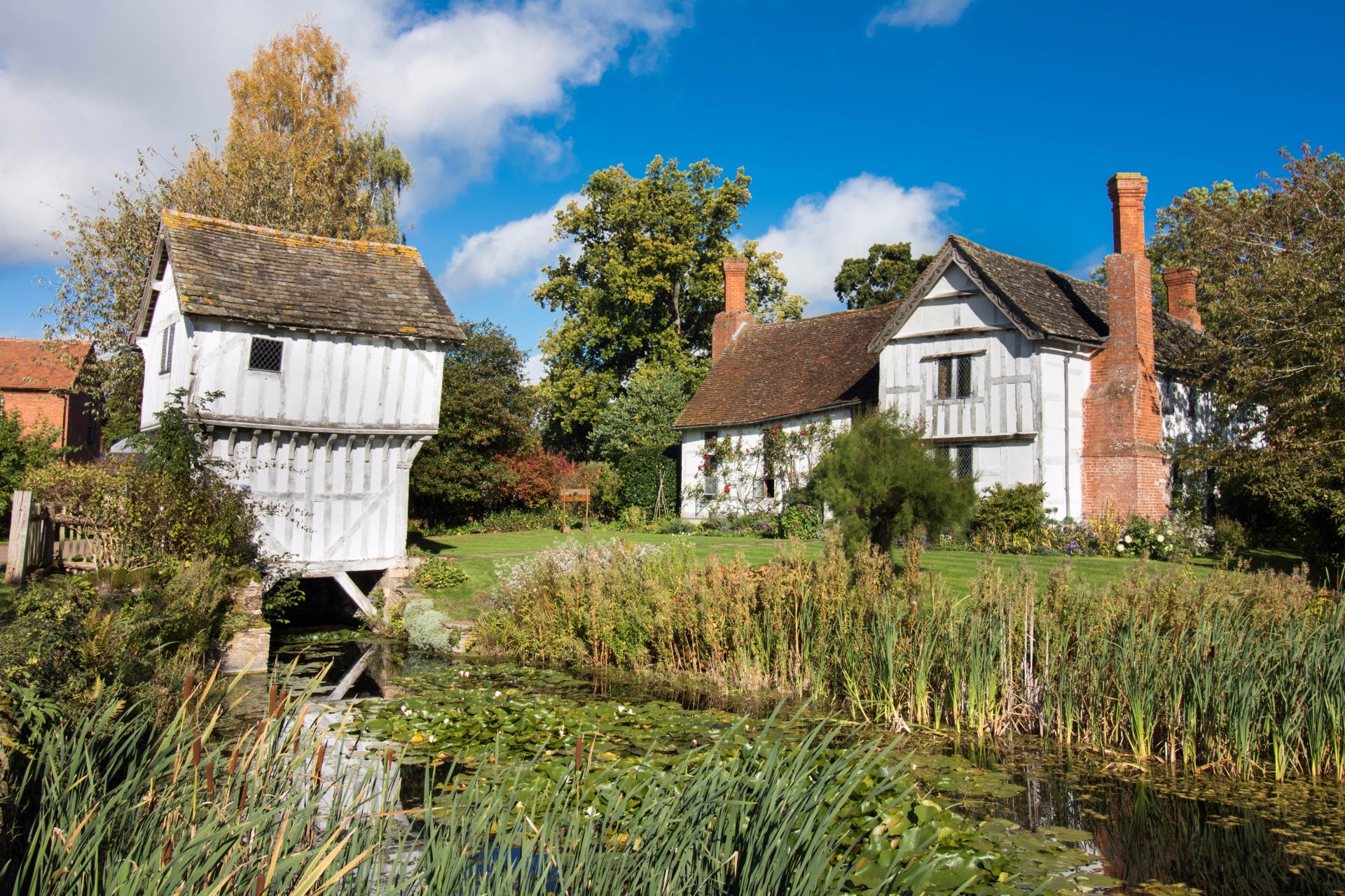 Brockhampton Estate Black and White Timber Building Moat Lily Pads Blue Sky Top 25 Things to Do in Herefordshire