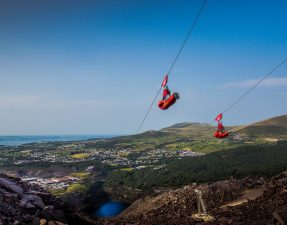 Zip World Velocity zipline world's fastest zipline Europe's longest zipline hills quarry sea blue skies Wales Romantic Travel Gift Ideas for Valentine's Day