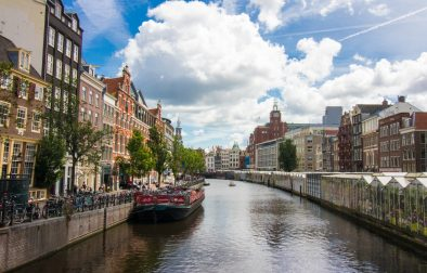 river-running-through-european-city-canal-with-flower-markets-and-buildings-on-either-side-on-a-hot-summers-day-two-days-in-amsterdam