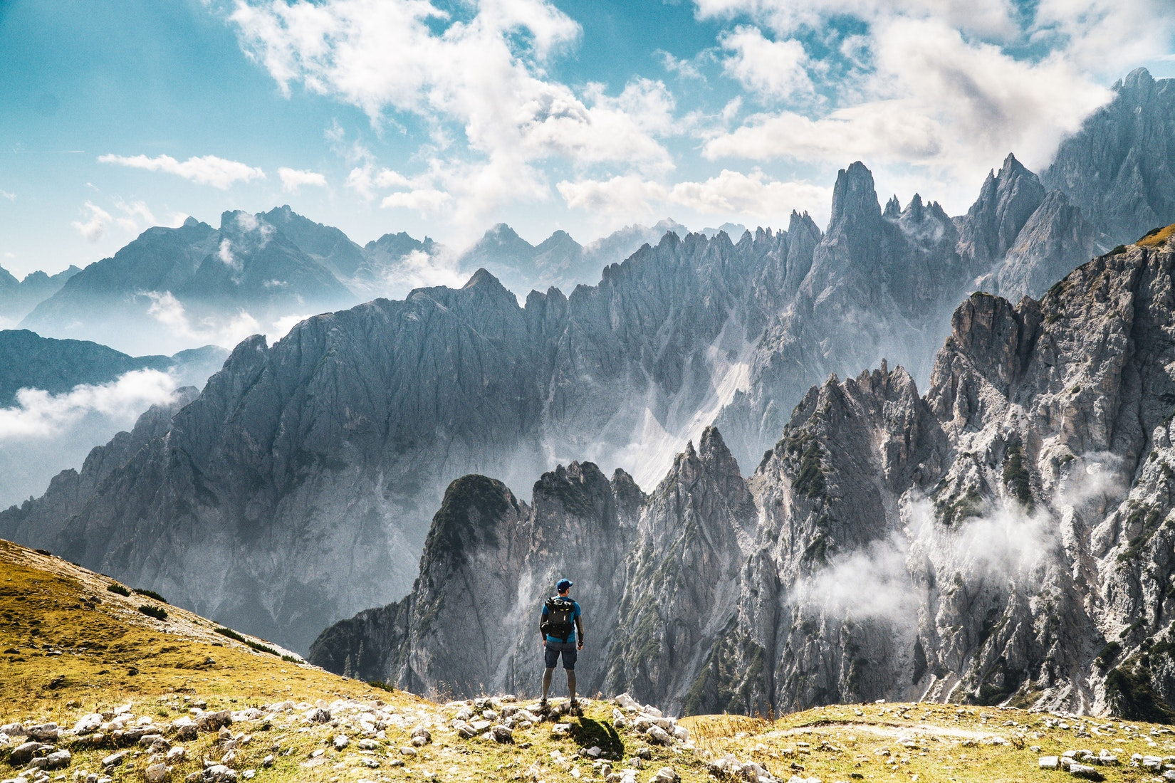 Man standing on mountain in the Dolomites in Trentino Italy travel goals