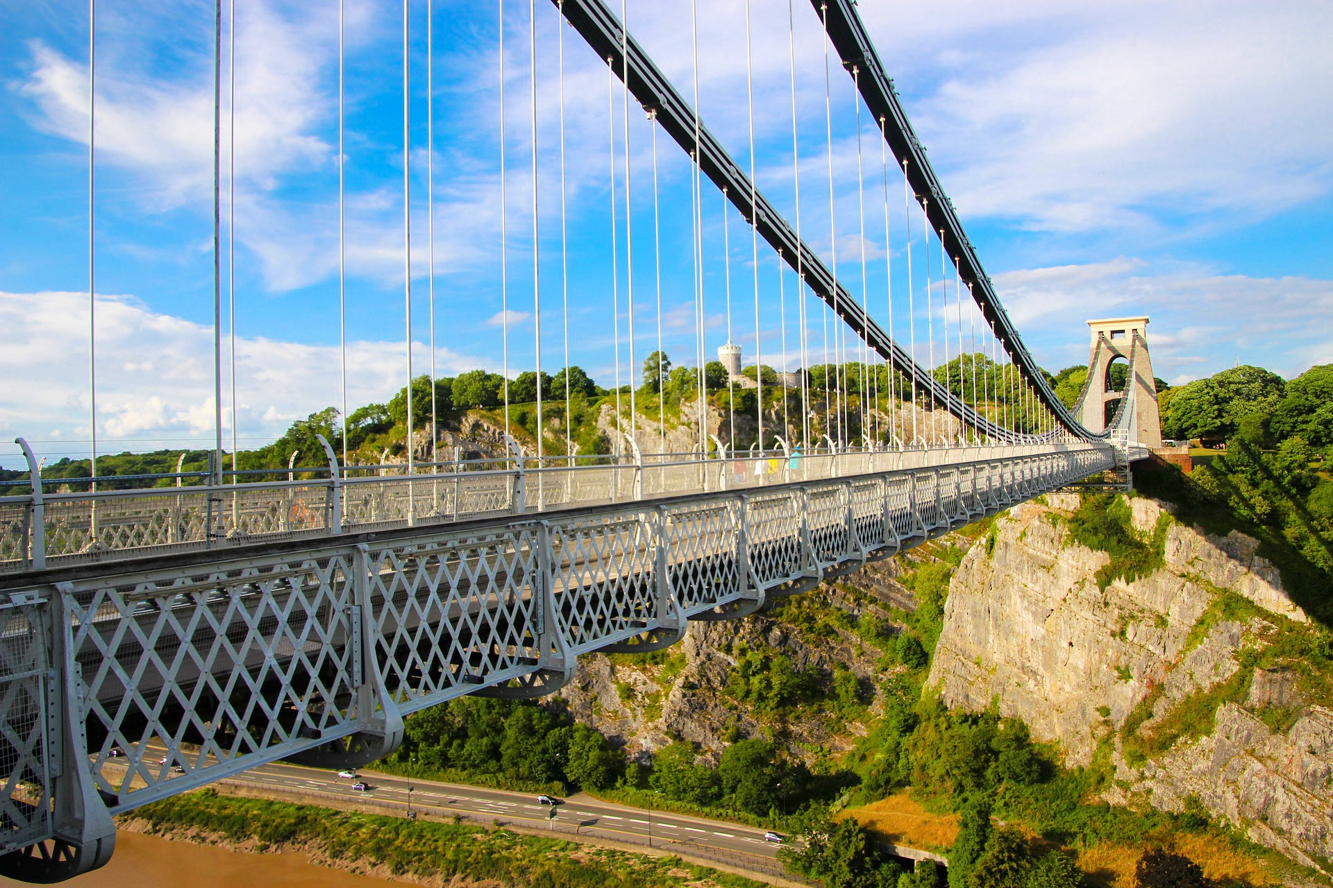 Clifton Suspension Bridge. Bristol. Big bridge. Impressive bridge. Huge bridge. Blue skies. Rocks. Trees. Road. 8 Great Day Trips from Exeter You Can't Miss. Exeter day trips. England, UK. Day trips from Devon. Day trips from Exeter Devon. Day trips from Exeter UK. Day trips from Exeter by train. Day tours from Exeter. Day tours from Exeter UK. Coach day trips from Exeter. Things to do in Exeter. Things to see in Exeter. Things to do in Devon. Exeter travel blog. Exeter travel guide. Bath. Bristol. Cardiff. Plymouth. English Riviera. Jurassic Coast. Dartmoor National Park. Cornwall. Click through to read more...