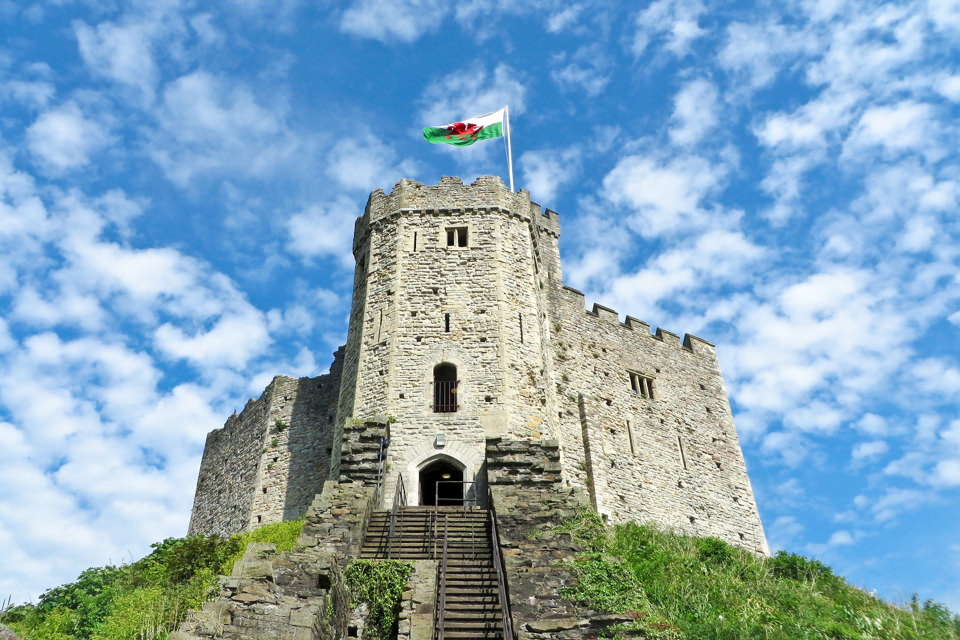Cardiff Castle. Historic castle. Welsh flag. Wales. Blue skies. Clouds. Steps to castle. 8 Great Day Trips from Exeter You Can't Miss. Exeter day trips. England, UK. Day trips from Devon. Day trips from Exeter Devon. Day trips from Exeter UK. Day trips from Exeter by train. Day tours from Exeter. Day tours from Exeter UK. Coach day trips from Exeter. Things to do in Exeter. Things to see in Exeter. Things to do in Devon. Exeter travel blog. Exeter travel guide. Bath. Bristol. Cardiff. Plymouth. English Riviera. Jurassic Coast. Dartmoor National Park. Cornwall. Click through to read more...