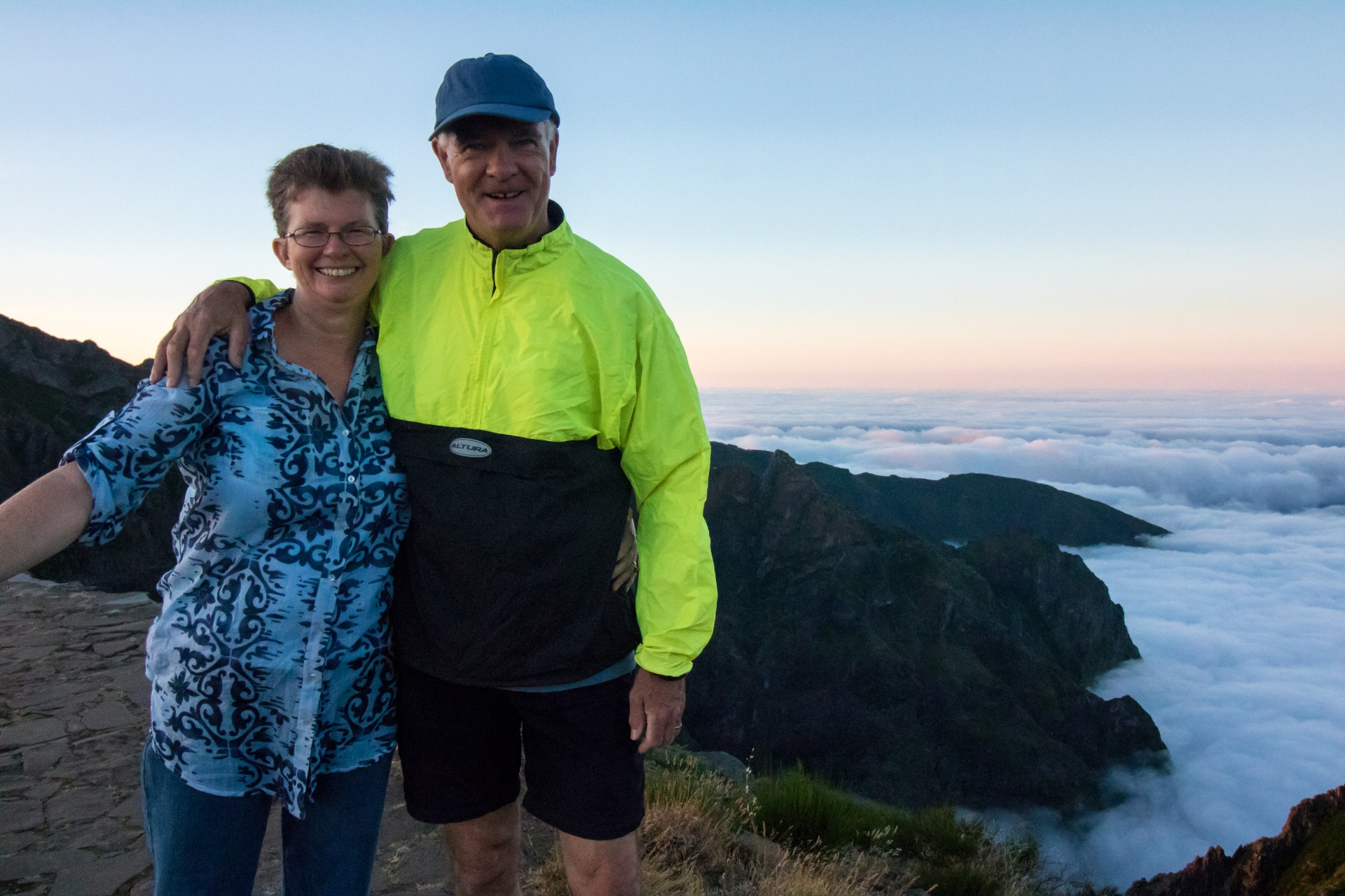 Man and woman husband and wife hiking mountain clouds Madeira Portugal Pico do Ariero travel goals