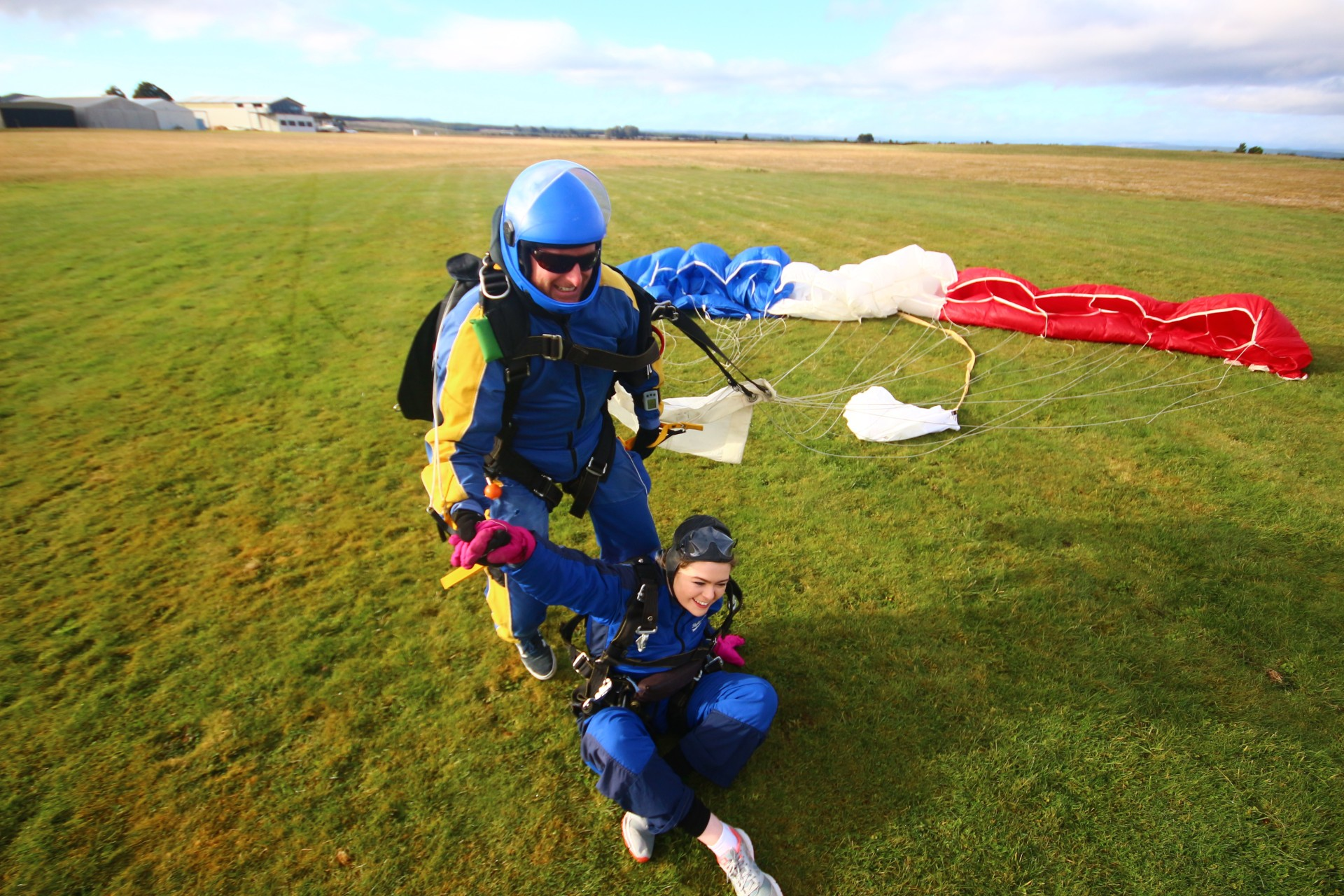 Skydive landing parachute girl on floor Skydive Taupo The Best Skydiving in New Zealand