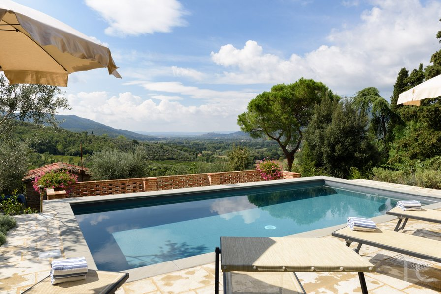 Pool view over fields and trees sunbathing villa Tuscany Italy travel goals
