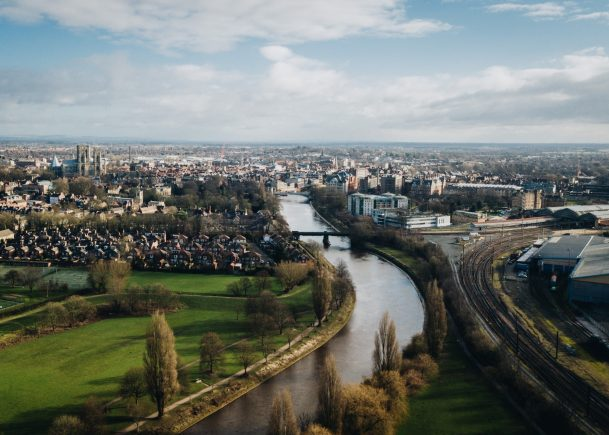 Historic city skyline river houses sky fields York Yorkshire England UK