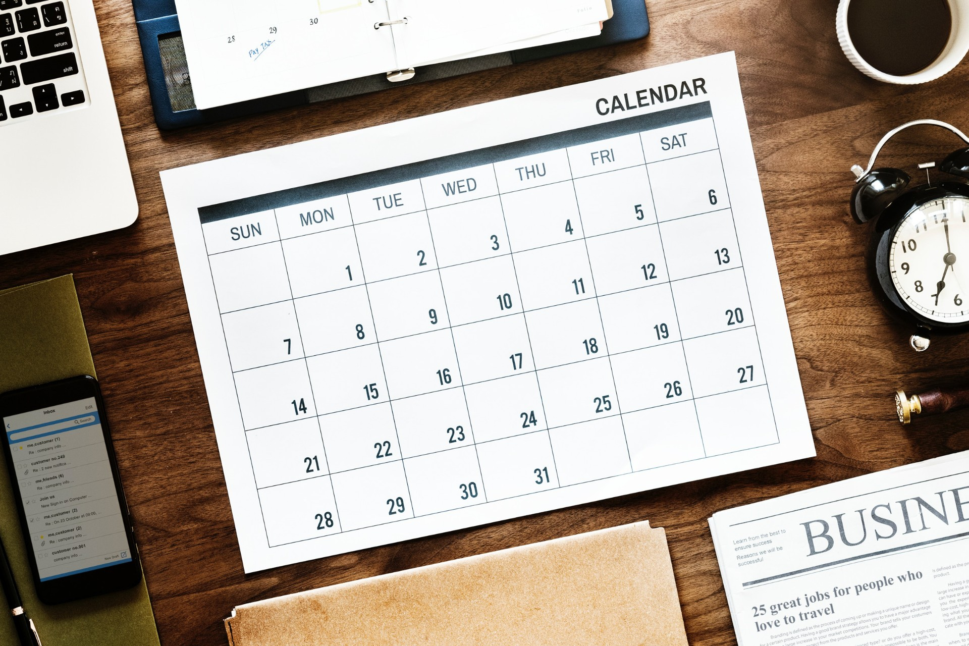 Calendar month dates diary schedule clock paper phone laptop planner on wood table Long distance relationship tips. Long distance relationship advice. Click through to read more...