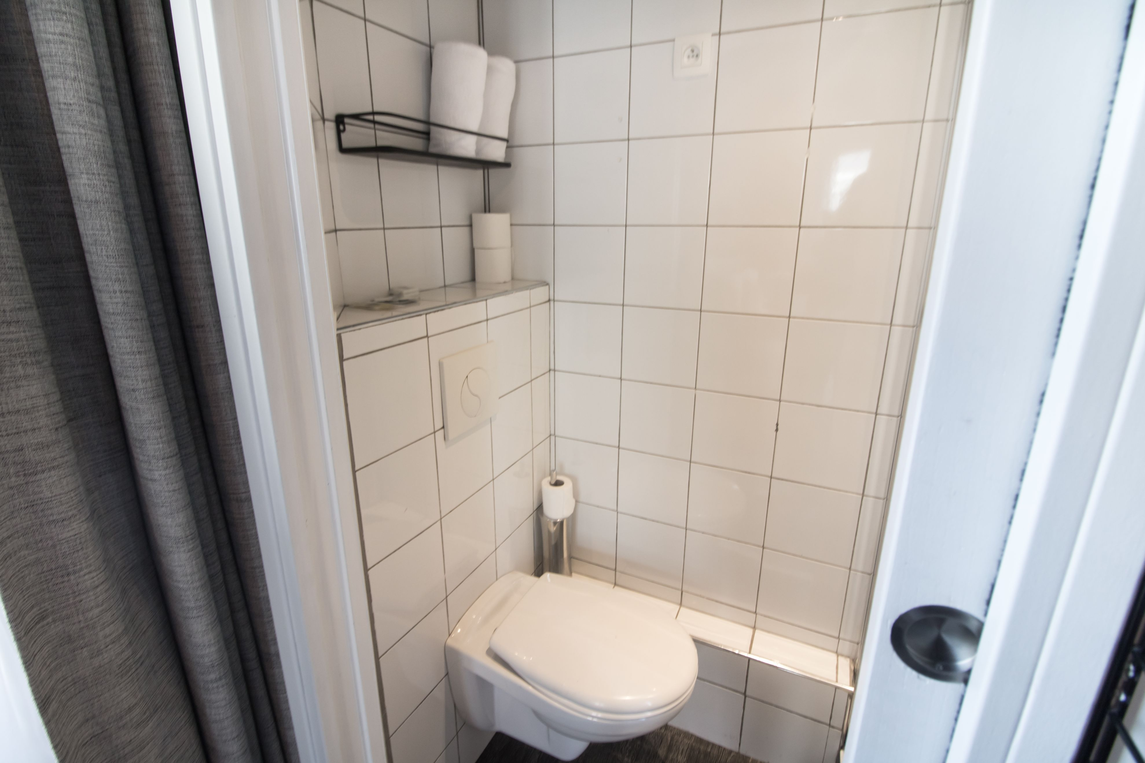 Clean, minimalistic white bathroom with toilet, toilet paper and towels. Hotel Baby Paris Review: The Best Budget Hotel in Paris. Paris hotel. Paris hotels. Paris France. Paris budget hotels. Best hotels in Paris. Paris accommodation. Cheap hotels in Paris. Paris hotel deals. Places to stay in Paris. Top hotels in Paris. Paris hotel booking. Where to stay in Paris. Cheap accommodation in Paris. Hotels in central Paris. Paris travel blog. Paris travel guide. Things to do in Paris. What to do in Paris. Places to See in Paris. Things to see in Paris. What to see in Paris. Click through to read more...