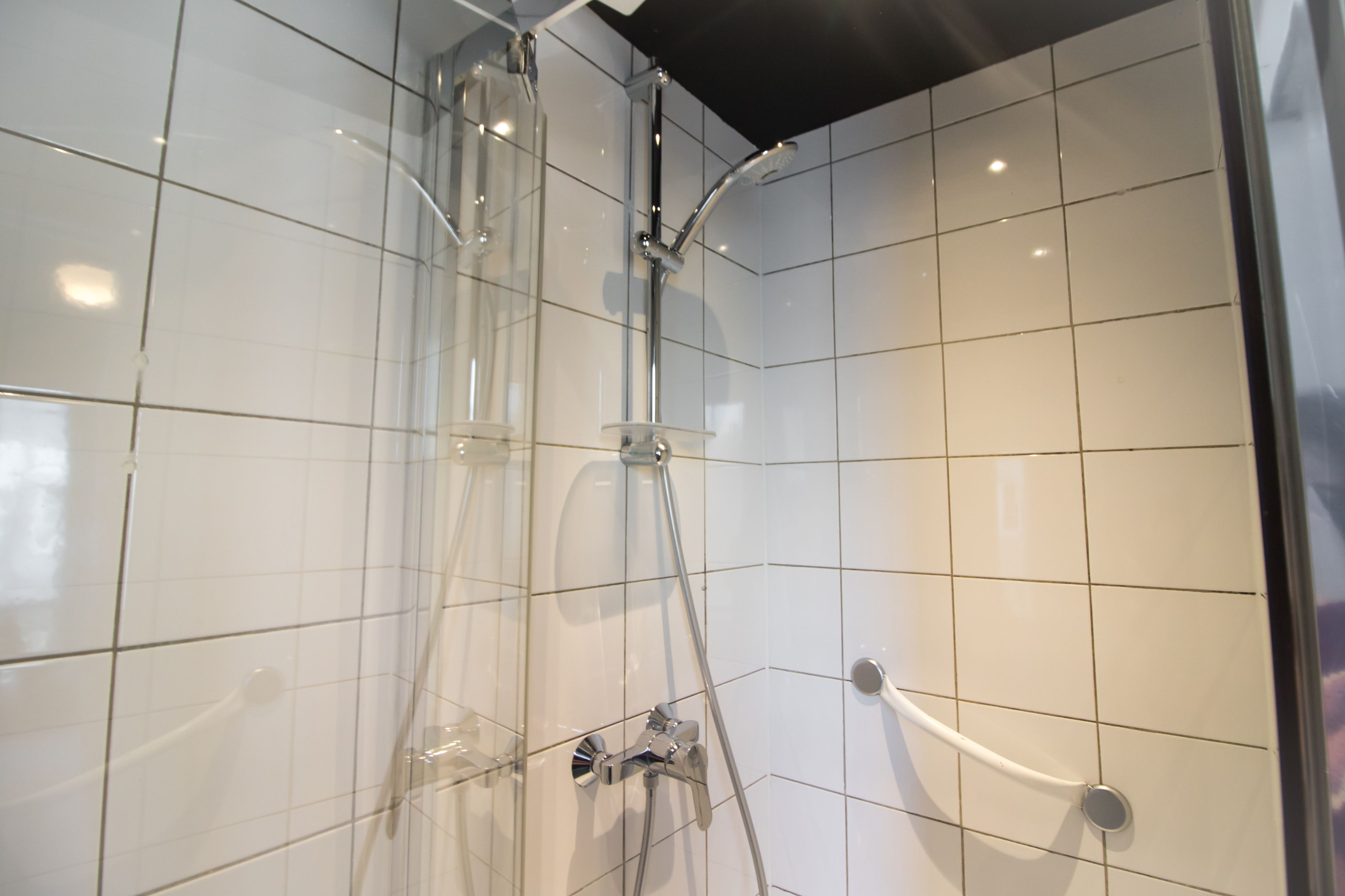 Clean, minimalistic white and silver shower in bathroom. Hotel Baby Paris Review: The Best Budget Hotel in Paris. Paris hotel. Paris hotels. Paris France. Paris budget hotels. Best hotels in Paris. Paris accommodation. Cheap hotels in Paris. Paris hotel deals. Places to stay in Paris. Top hotels in Paris. Paris hotel booking. Where to stay in Paris. Cheap accommodation in Paris. Hotels in central Paris. Paris travel blog. Paris travel guide. Things to do in Paris. What to do in Paris. Places to See in Paris. Things to see in Paris. What to see in Paris. Click through to read more...