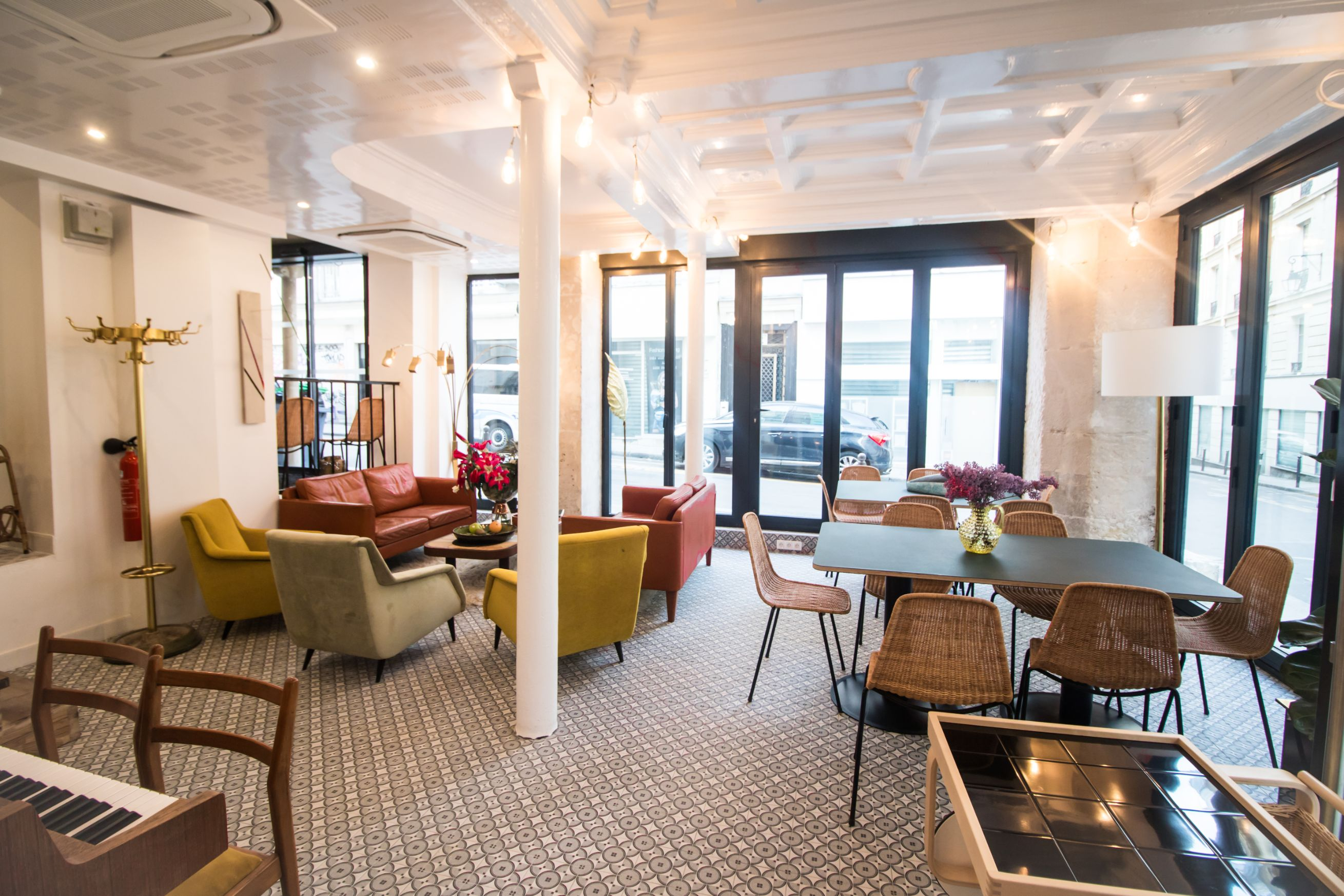 Bright hotel lobby with a quirky, unique interior and Scandinavian style. Tables and chairs. Mustard seats. Piano. Hotel Baby Paris Review: The Best Budget Hotel in Paris. Paris hotel. Paris hotels. Paris France. Paris budget hotels. Best hotels in Paris. Paris accommodation. Cheap hotels in Paris. Paris hotel deals. Places to stay in Paris. Top hotels in Paris. Paris hotel booking. Where to stay in Paris. Cheap accommodation in Paris. Hotels in central Paris. Paris travel blog. Paris travel guide. Things to do in Paris. What to do in Paris. Places to See in Paris. Things to see in Paris. What to see in Paris. Click through to read more...
