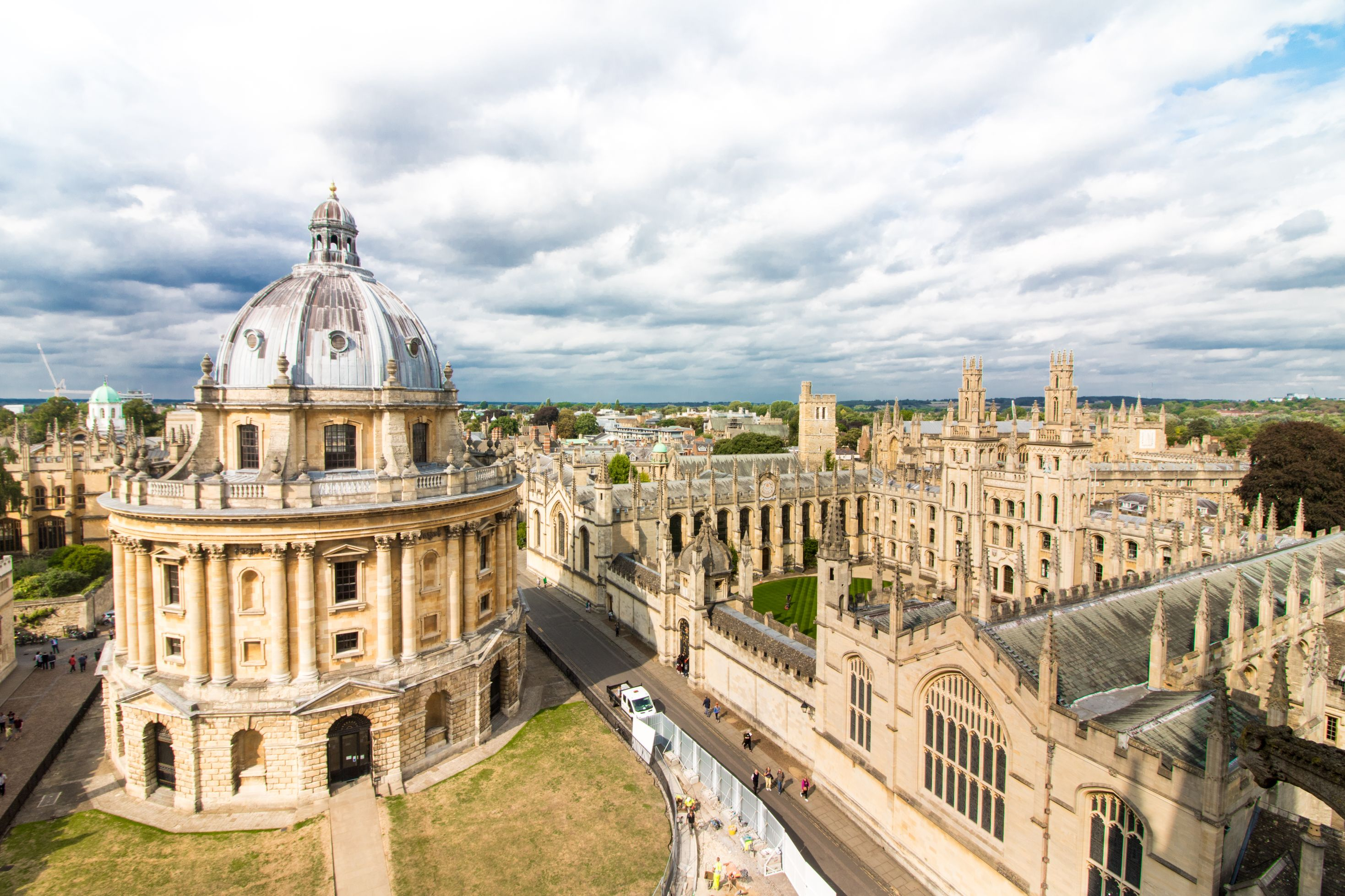 Views of Oxford England from above from University Church of St Mary Tower. Radcliffe Camera. Oxford University colleges. Old historic buildings and castles. Blue cloudy sky. How to Spend One Day in Oxford: Best Things to Do. Oxford England. Oxford UK. Oxford University. 24 hours in Oxford. Oxford in One Day. Things to do in Oxford. Places to see in Oxford. Places to Visit in Oxford. What to see in Oxford. Things to see in Oxford. What to do in Oxford. Oxford attractions. Oxford top attractions. Oxford travel blog. Oxford travel guide. Oxford Castle. Turl Street. Oxford bookshops. Bridge of Sighs. Bodleian Library. Radcliffe Camera. University Church of St Mary. Oxford punting. Click through to read more...