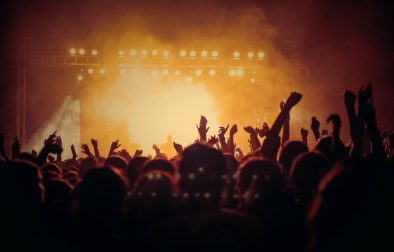 Crowd of people at a gig, concert or party in a club. Bright orange lights and smoke. 9 Things I Wish I Knew When I Started University