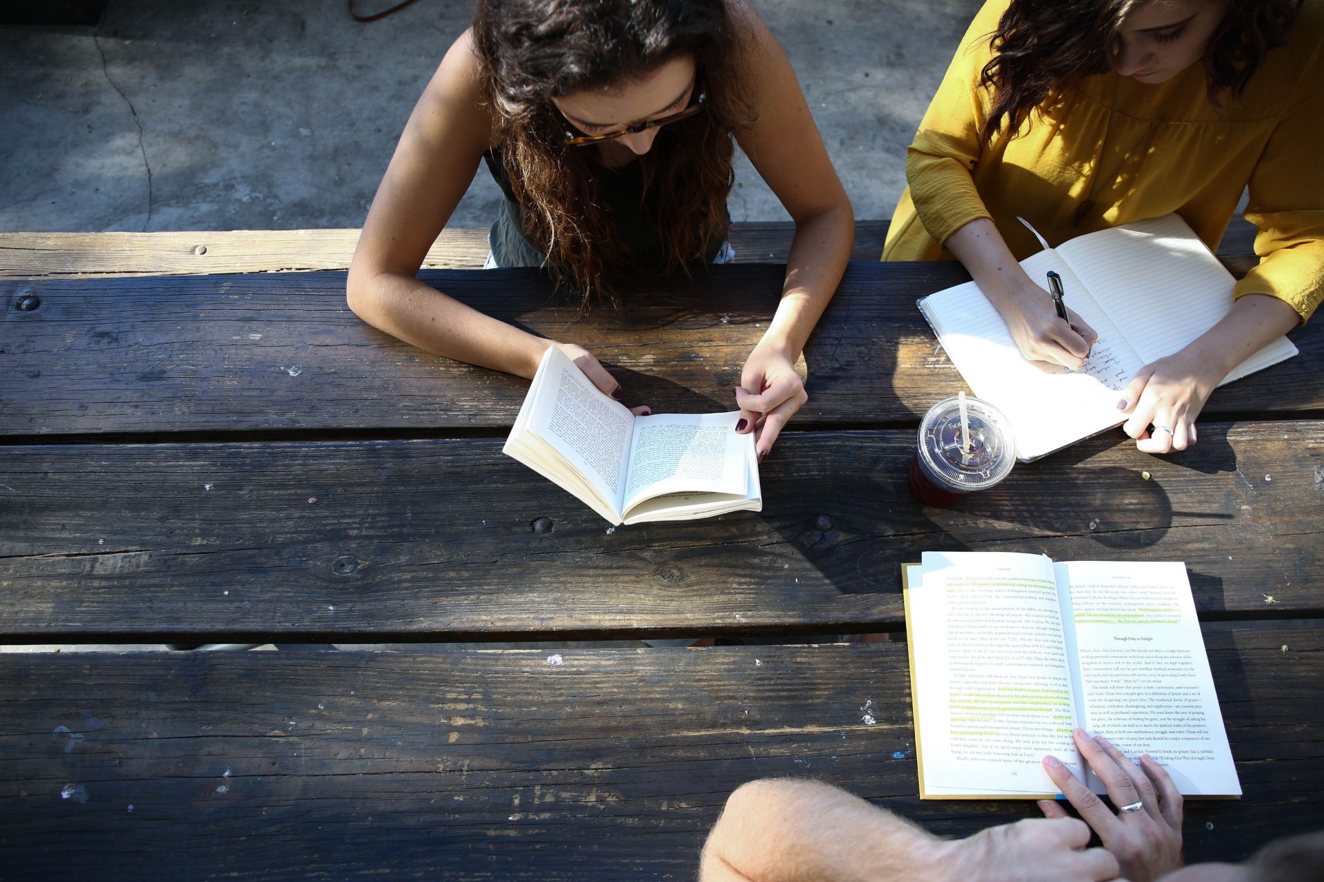 Group of friends reading, writing and working at a picnic table. 9 Things I Wish I Knew When I Started University
