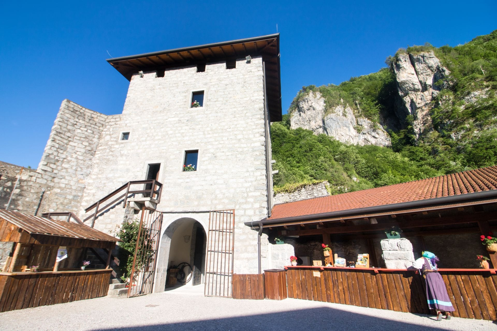 old-italian-castle-courtyard-set-against-cliff-castello-san-giovanni-valle-del-chiese-trentino-italy