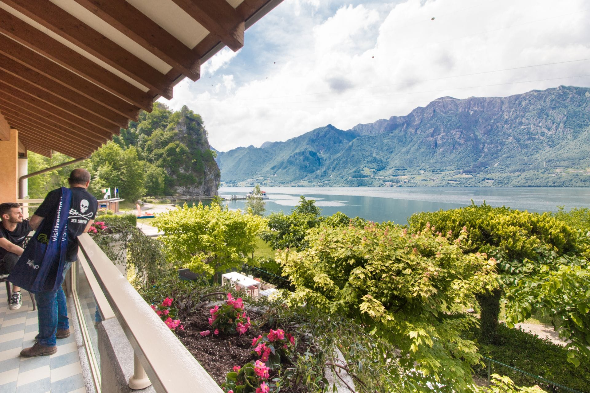 restaurant-bar-terrace-overlooking-trees-alake-and-mountains-lake-idro-valle-del-chiese-trentino-italy