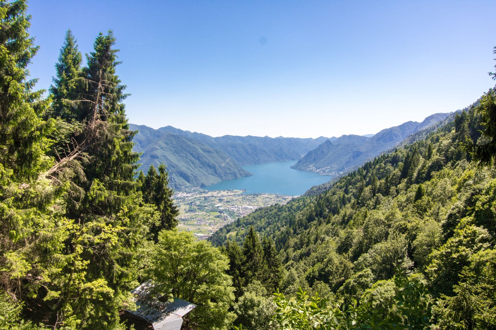 view-from-darzo-mine-in-the-mountains-across-a-valley-and-lake-valle-del-chiese-trentino-italy