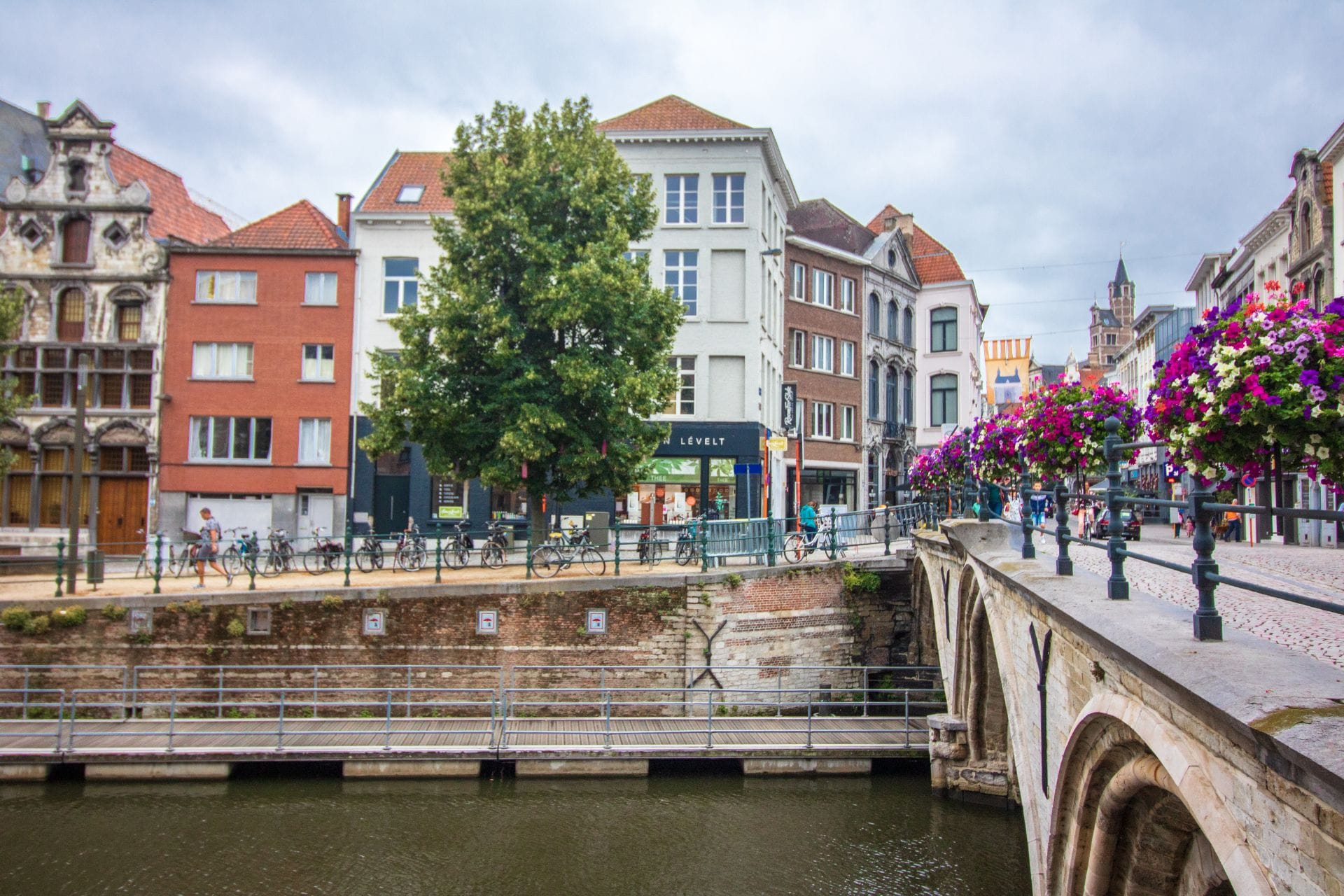 bridge-crossing-a-bike-lined-river-in-a-cute-european-city-with-colourful-houses-dylepath-things-to-do-in-mechelen-beligum