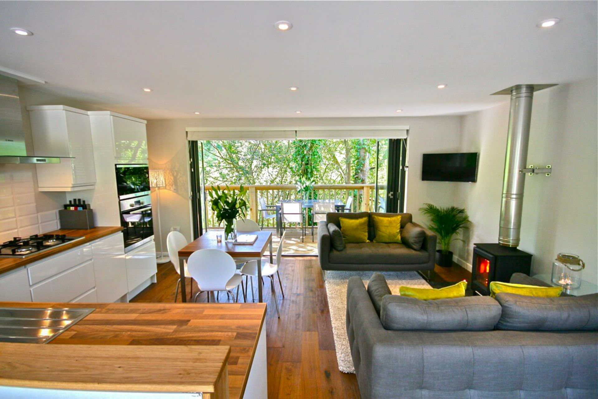 gorgeous-modern-open-plan-kitchen-and-lounge-living-room-with-wood-burner-in-a-treehouse-sunridge-treehouse-south-hams-devon