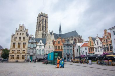 pretty-european-central-square-with-a-cathedral-colourful-buildings-and-outdoor-restaurants-grote-markt-things-to-do-in-mechelen-belgium
