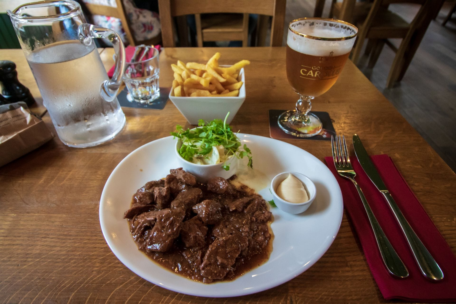 traditional-flemish-stew-with-fries-water-and-gouden-carolus-beer-het-anker-brewery-restaurant