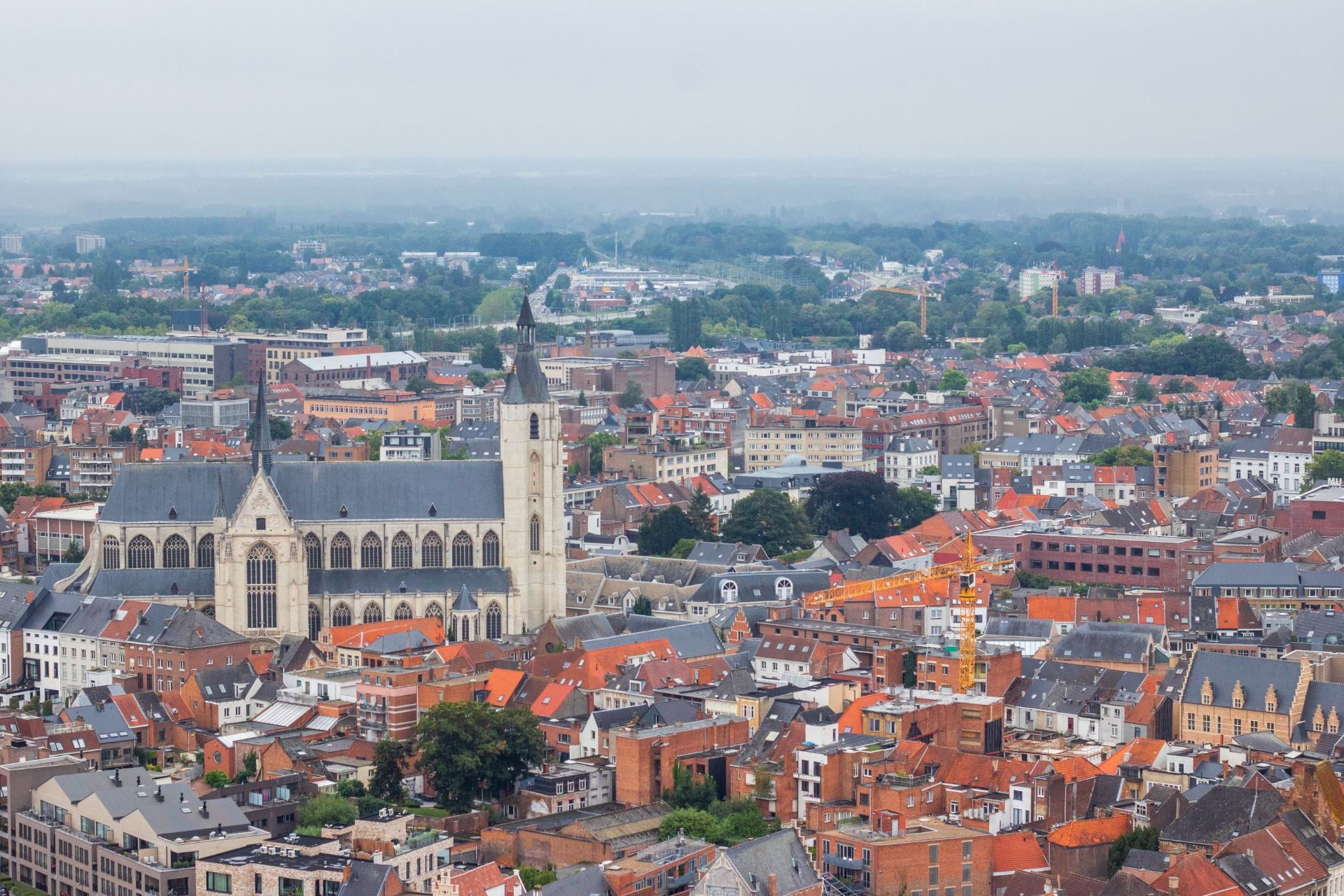 views-of-a-european-city-a-church-and-orange-rooftops-and-countryside-in-distance-st-rumbolds-tower-cathedral-skywalk-things-to-do-in-mechelen-belgium