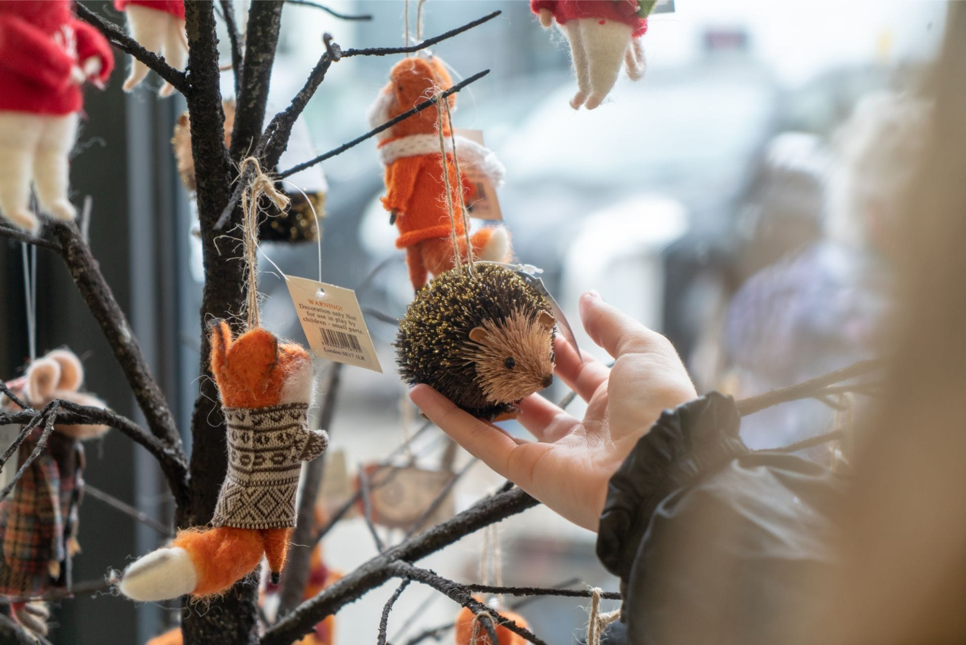 hedgehog-christmas-decoration-ornament-hanging-off-wood-tree-in-shop-the-gower-gallery-mumbles-swansea-bay-wales