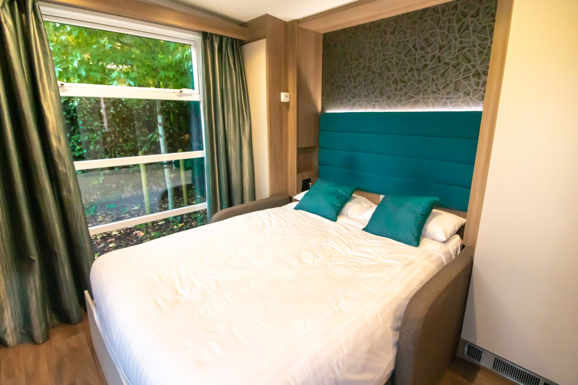 double-bed-interior-of-outdoor-glamping-pod-at-oxwich-bay-hotel-secret-garden