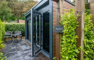 quirky-outdoor-accommodation-pod-with-an-outdoor-seating-area-surrounded-by-greenery-in-oxwich-bay-hotel-secret-garden