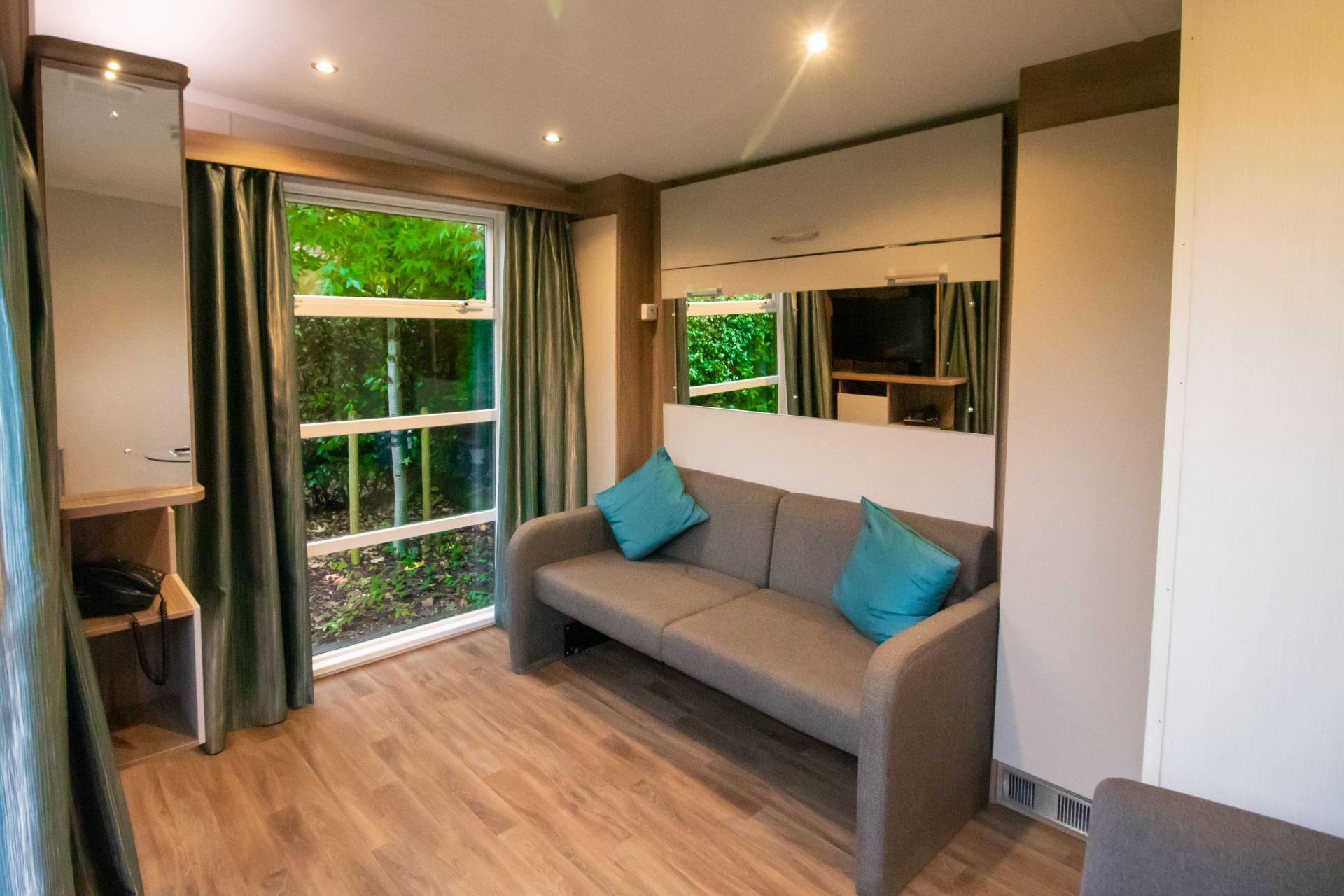 sofa-in-hotel-bedroom-in-oxwich-bay-hotel-secret-garden-pods