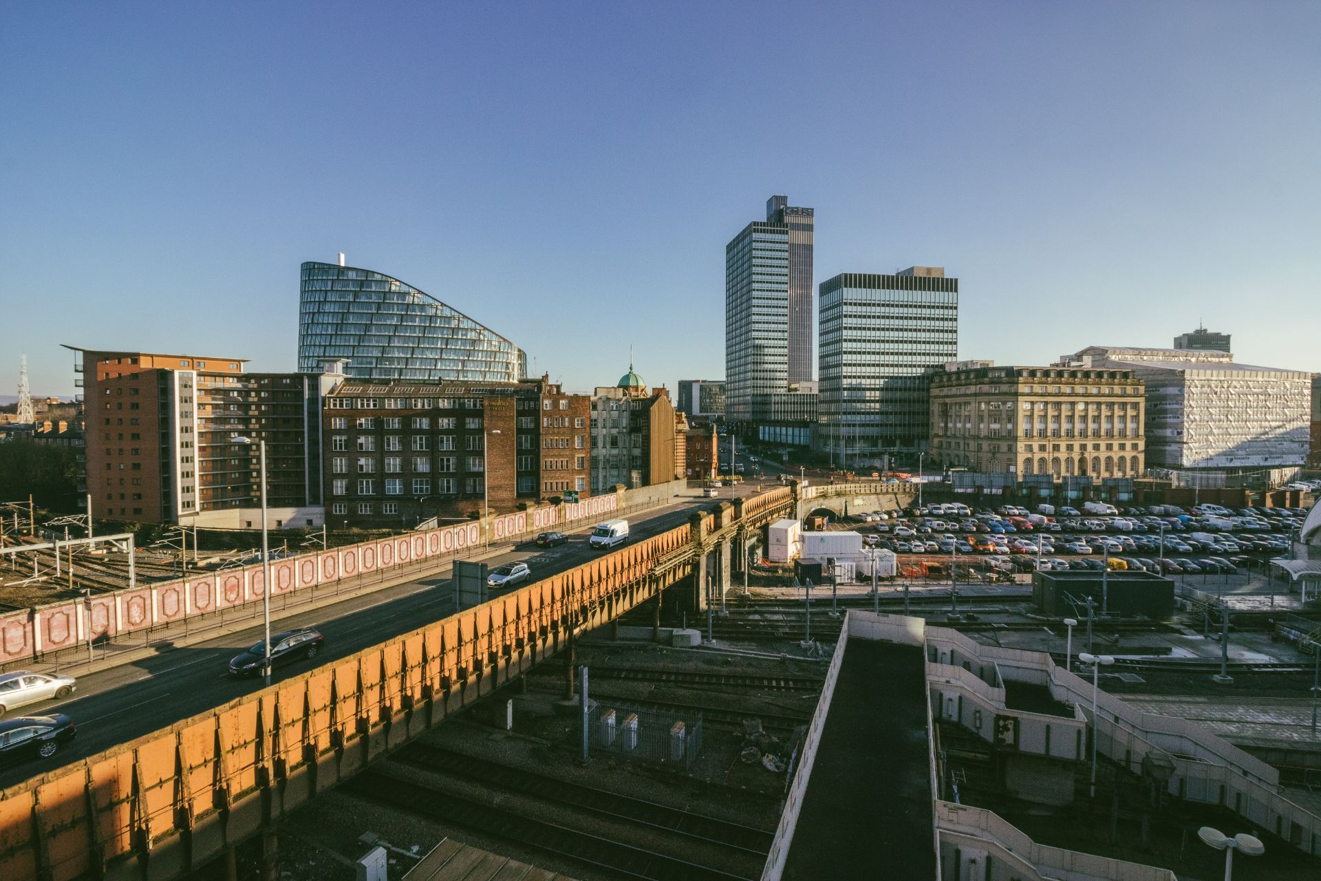 road-going-through-built-up-british-city-manchester-england-uk