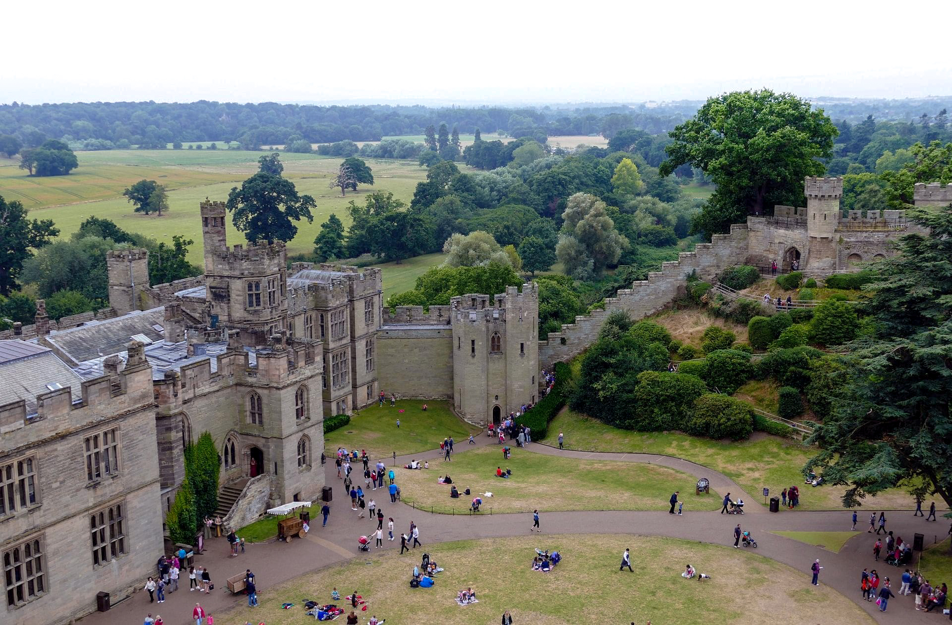 warwick-castle-in-england-uk-tourists-at-historic-attraction-in-castle-gardens