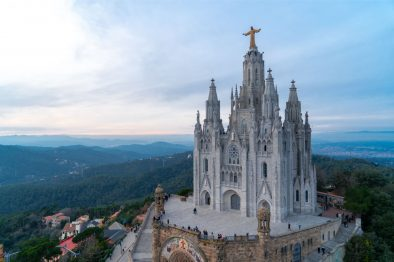 grand-church-cathedral-sitting-on-a-hill-at-sunset-#temple-of-the-secret-heart-of-jesus-at-tibidabo-amusement-park-two-days-in-barcelona