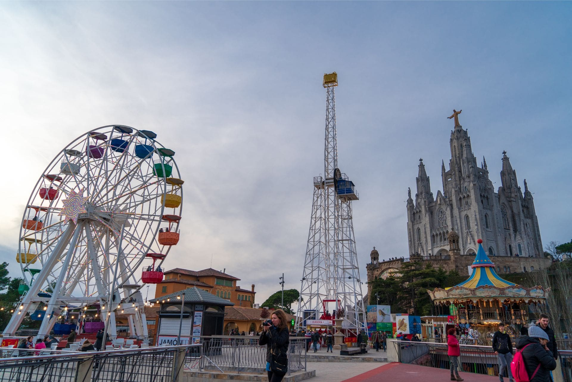 theme-park-ferris-wheel-rides-at-tibidabo-amusement-park-at-the-highest-point-in-barcelona-at-sunset