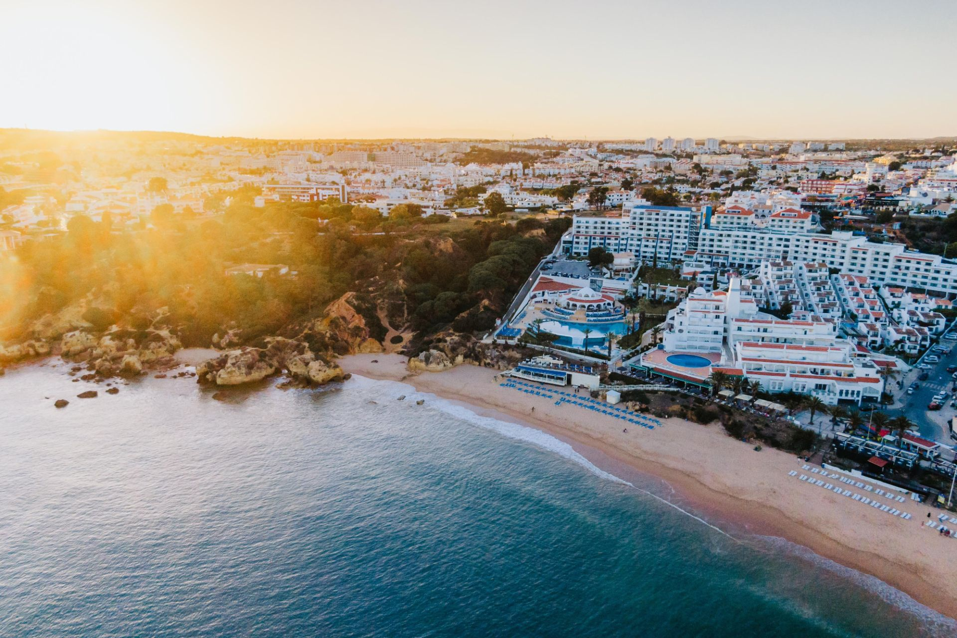 gorgeous-mediterranean-seaside-resort-at-golden-hour-blue-sea-white-sandy-beach-and-white-houses-in-town