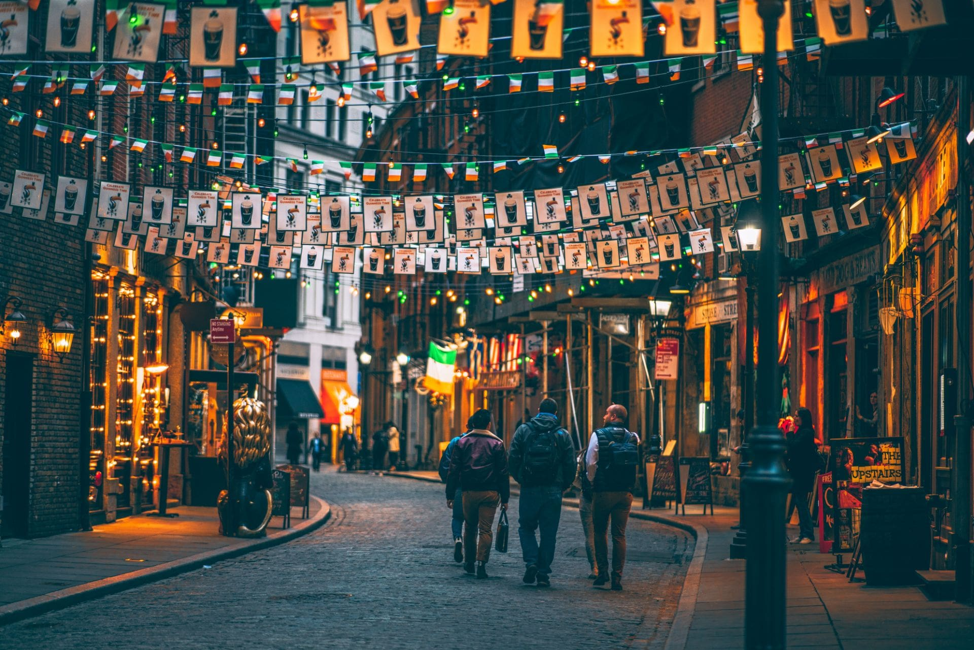 irish-street-with-pubs-at-night-lined-with-guiness-and-irish-flag-bunting-stone-street-in-new-york-in-4-days