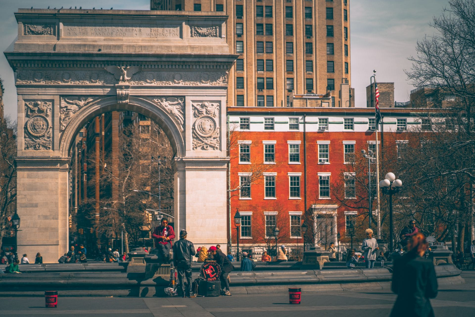 locals-relaxing-by-washington-square-arch-in-washington-square-park-in-new-york-city