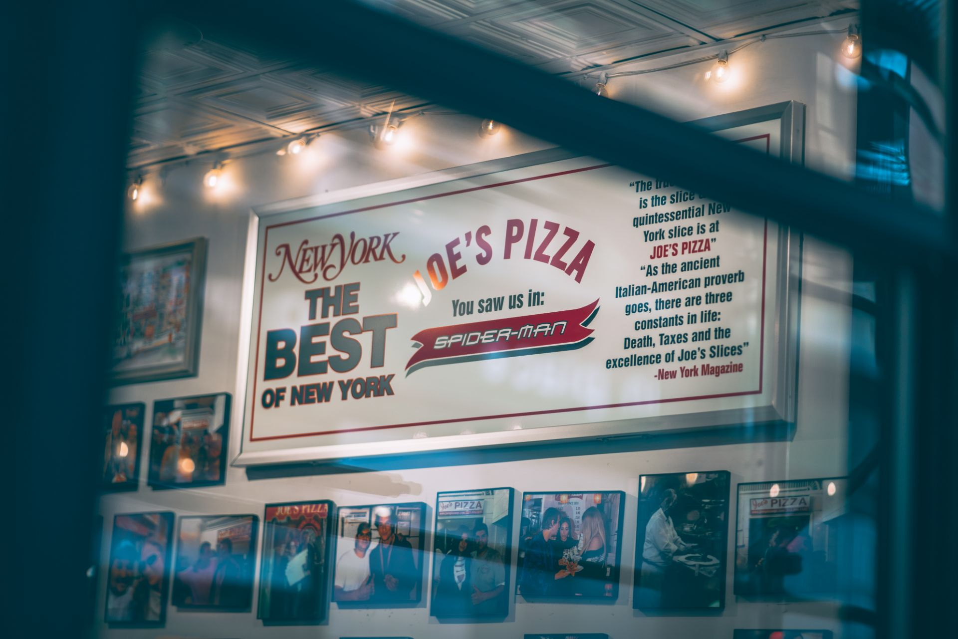 looking-through-a-window-into-joes-pizza-a-cheap-pizza-point-in-new-york