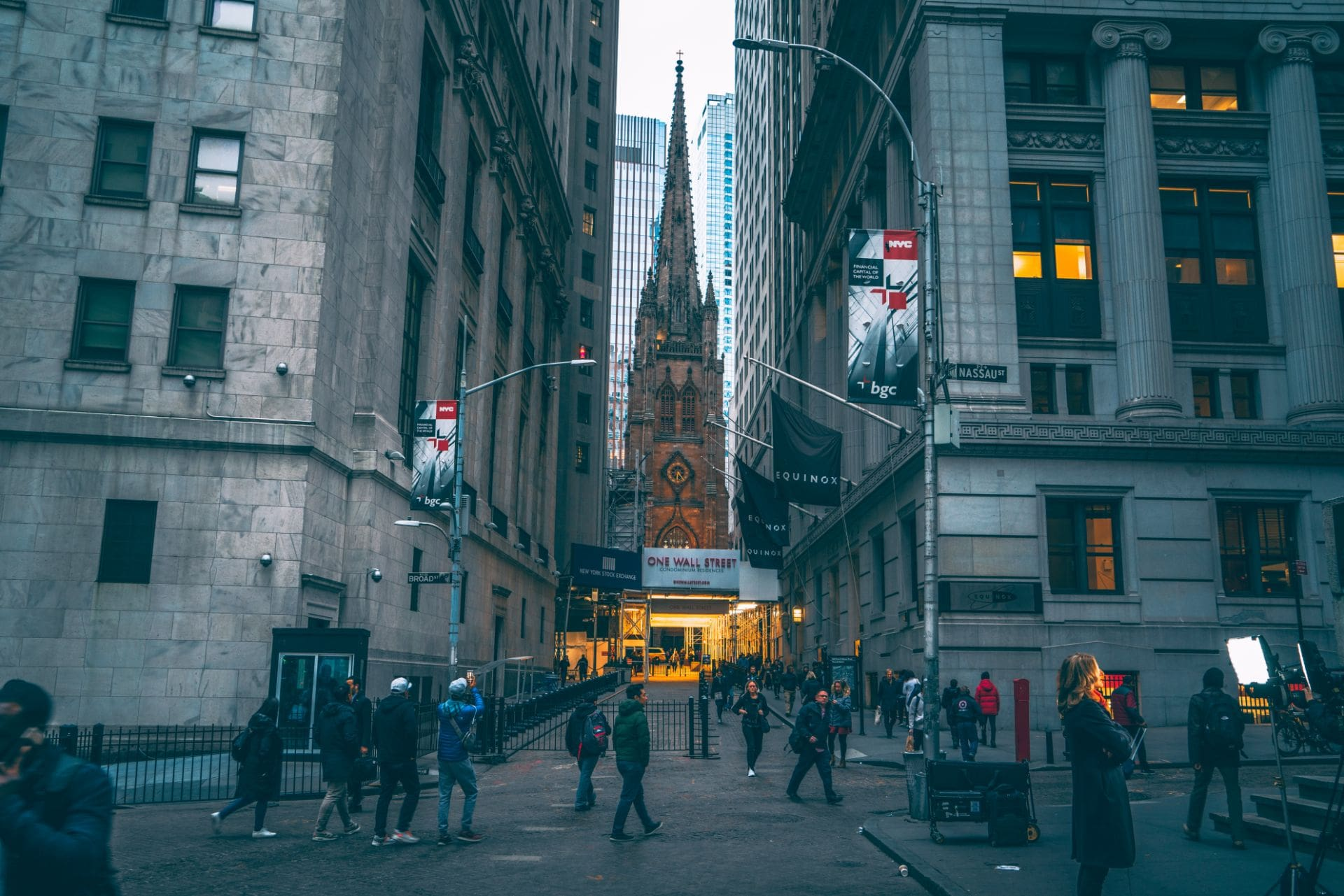 people-walking-down-wall-street-at-sunset