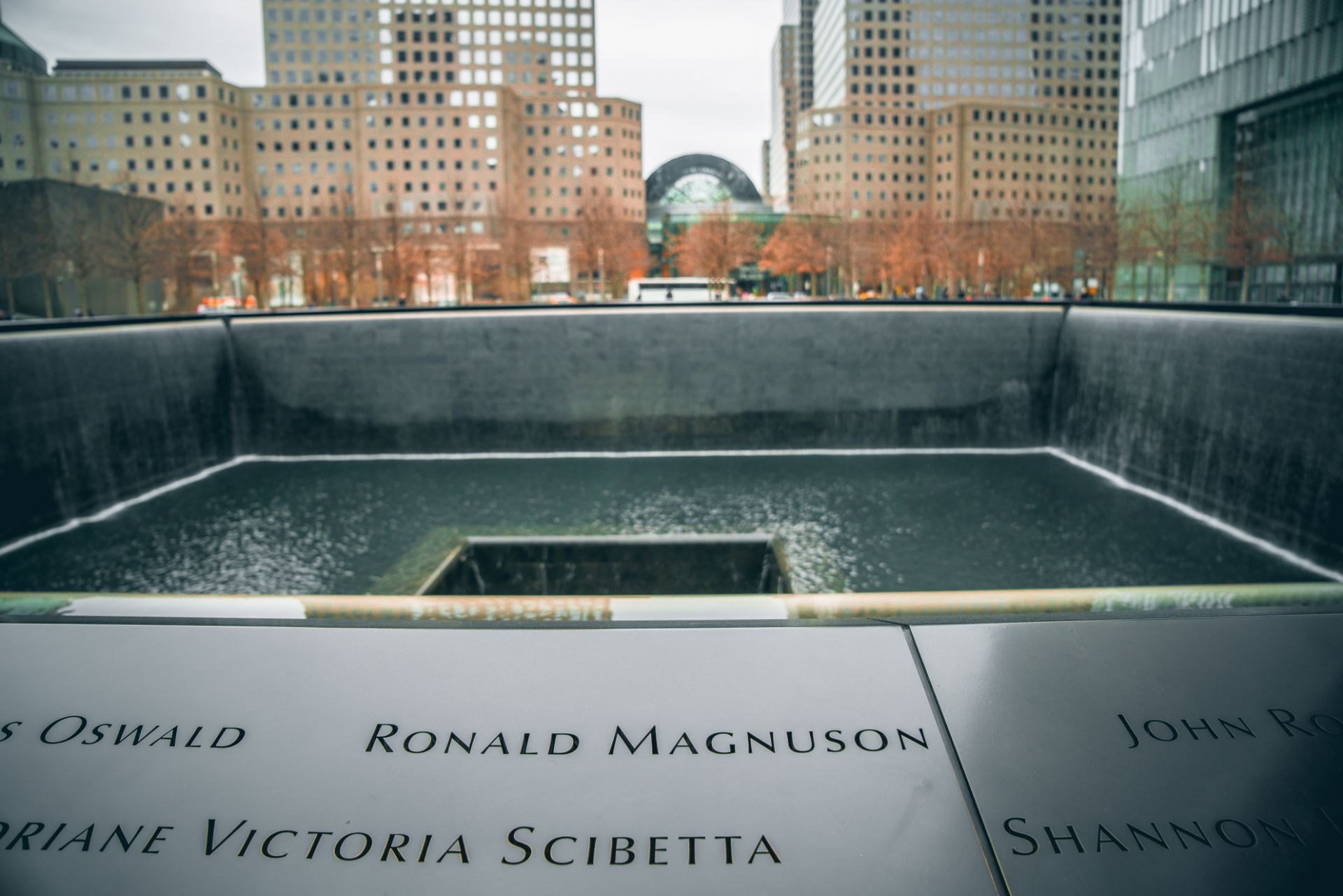 peoples-names-surrounding-a-pool-of-water-at-911-memorial-and-museum