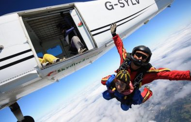woman-jumping-out-of-plane-tandem-skydiving-in-swansea-gower-peninsula-outdoor-activities-wales