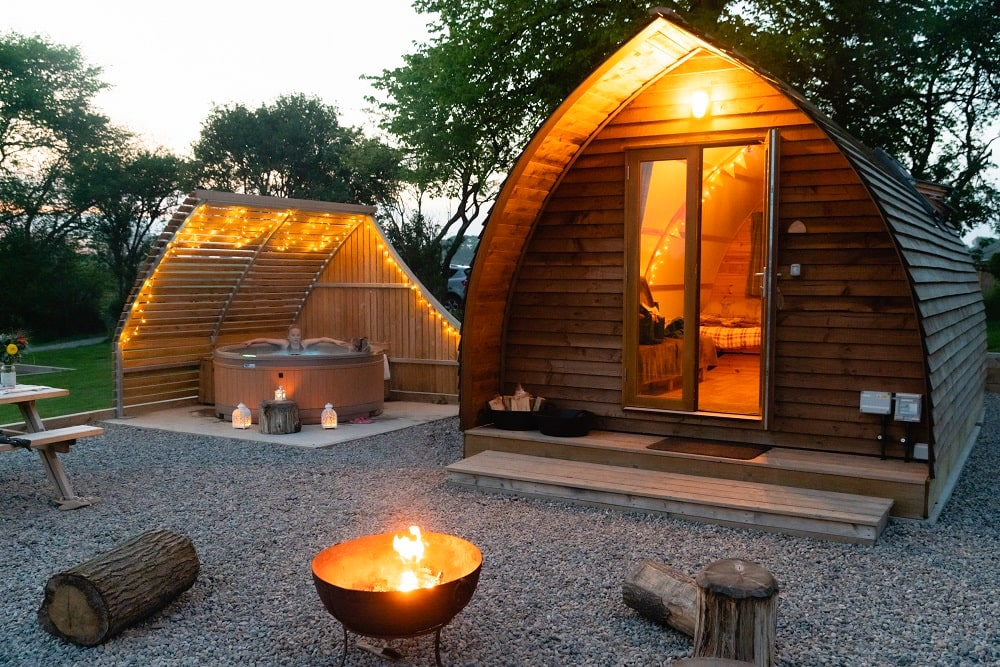 wooden-pod-on-a-platform-at-night-with-a-hot-tub-on-the-decking-sedgewell-barn-cabins-north-allerton-glamping-with-hot-tub-yorkshire