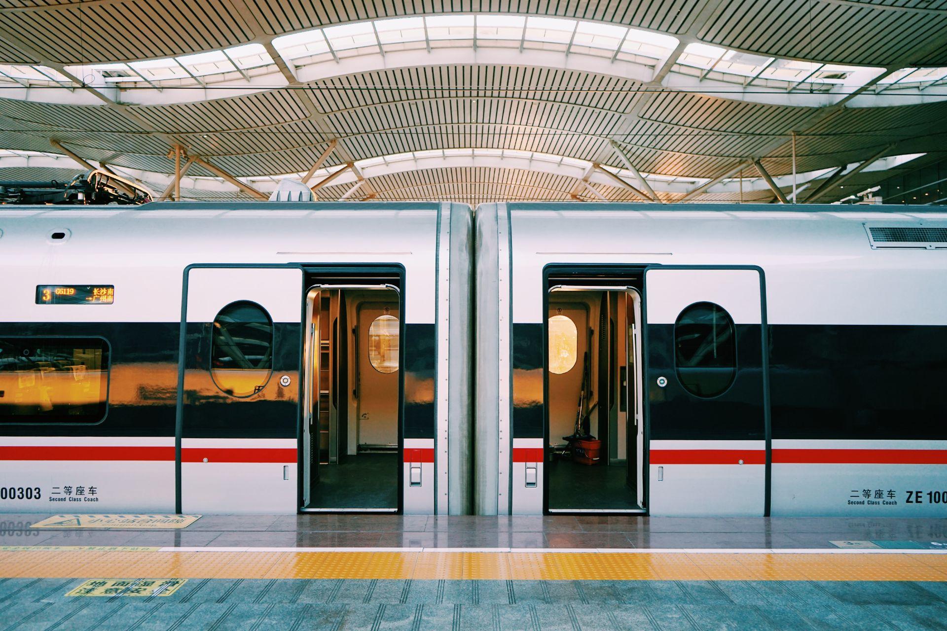 train-in-europe-with-doors-open-at-platform-interrailing-interrail