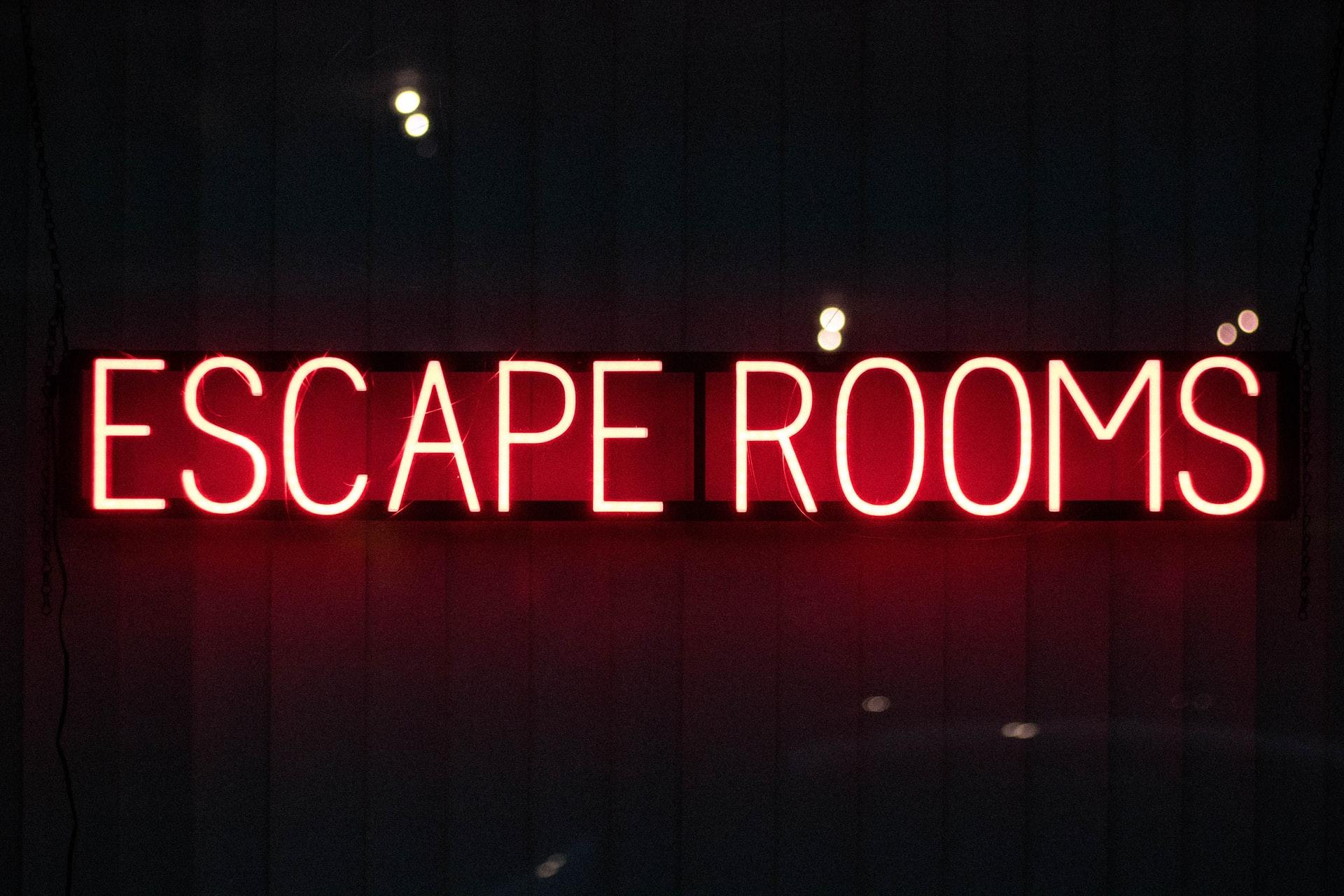 neon-red-escape-rooms-sign-in-dark-room