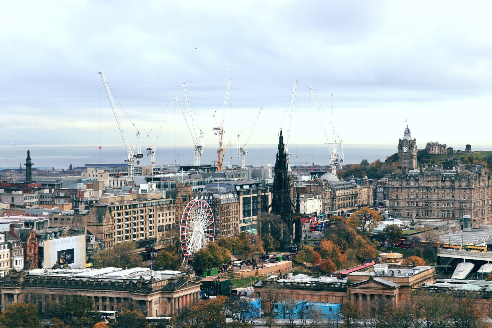 view-from-above-of-edinburgh-princes-street-gardens-with-sea-in-background