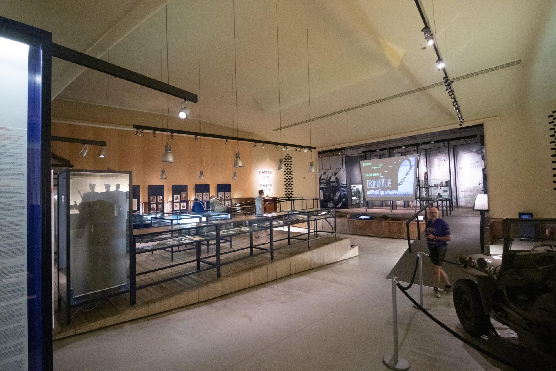 a-few-men-walking-around-allied-museum-free-museums-in-berlin