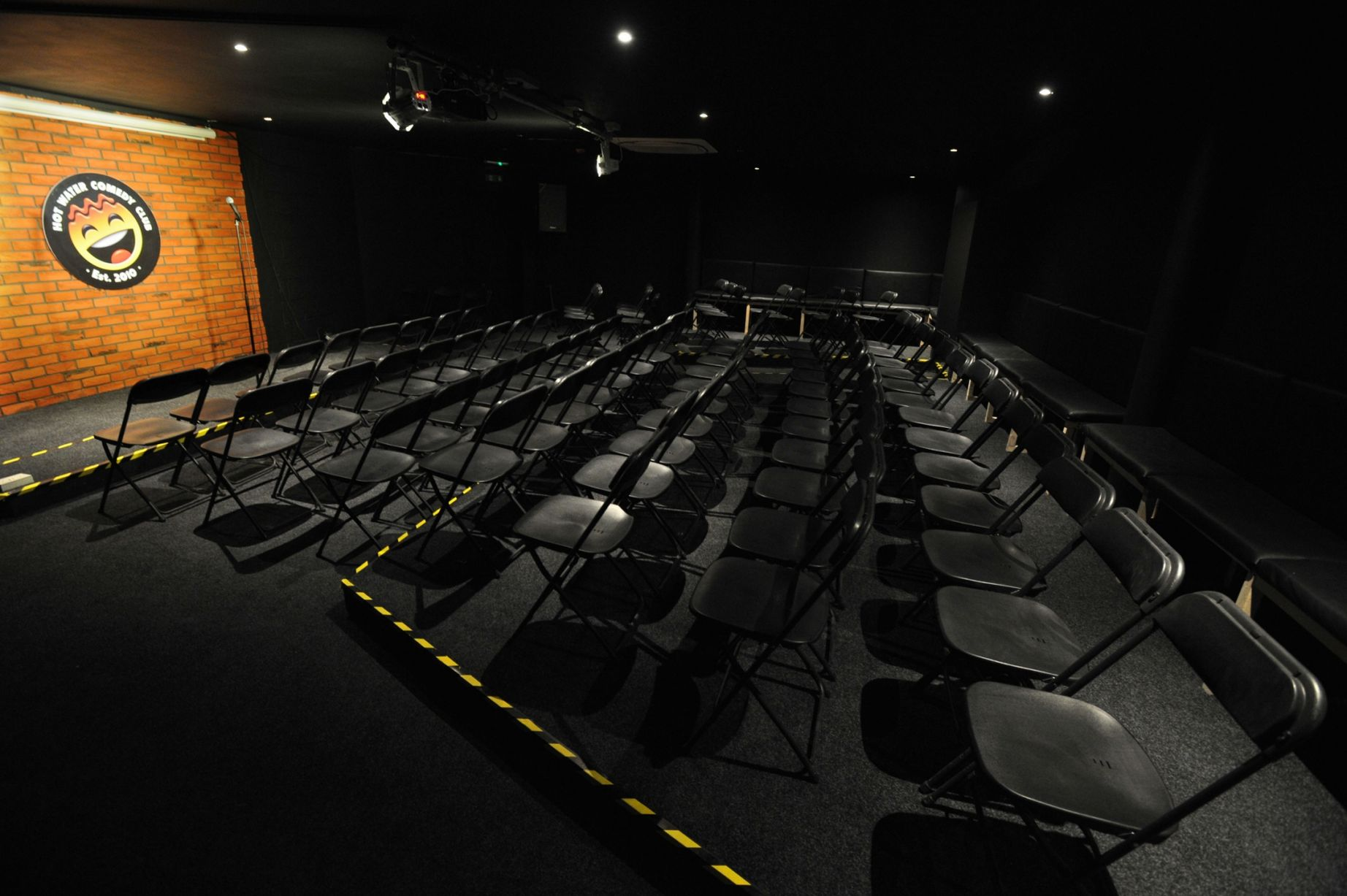 empty-venue-with-stage-and-black-seats-hot-water-comedy-club