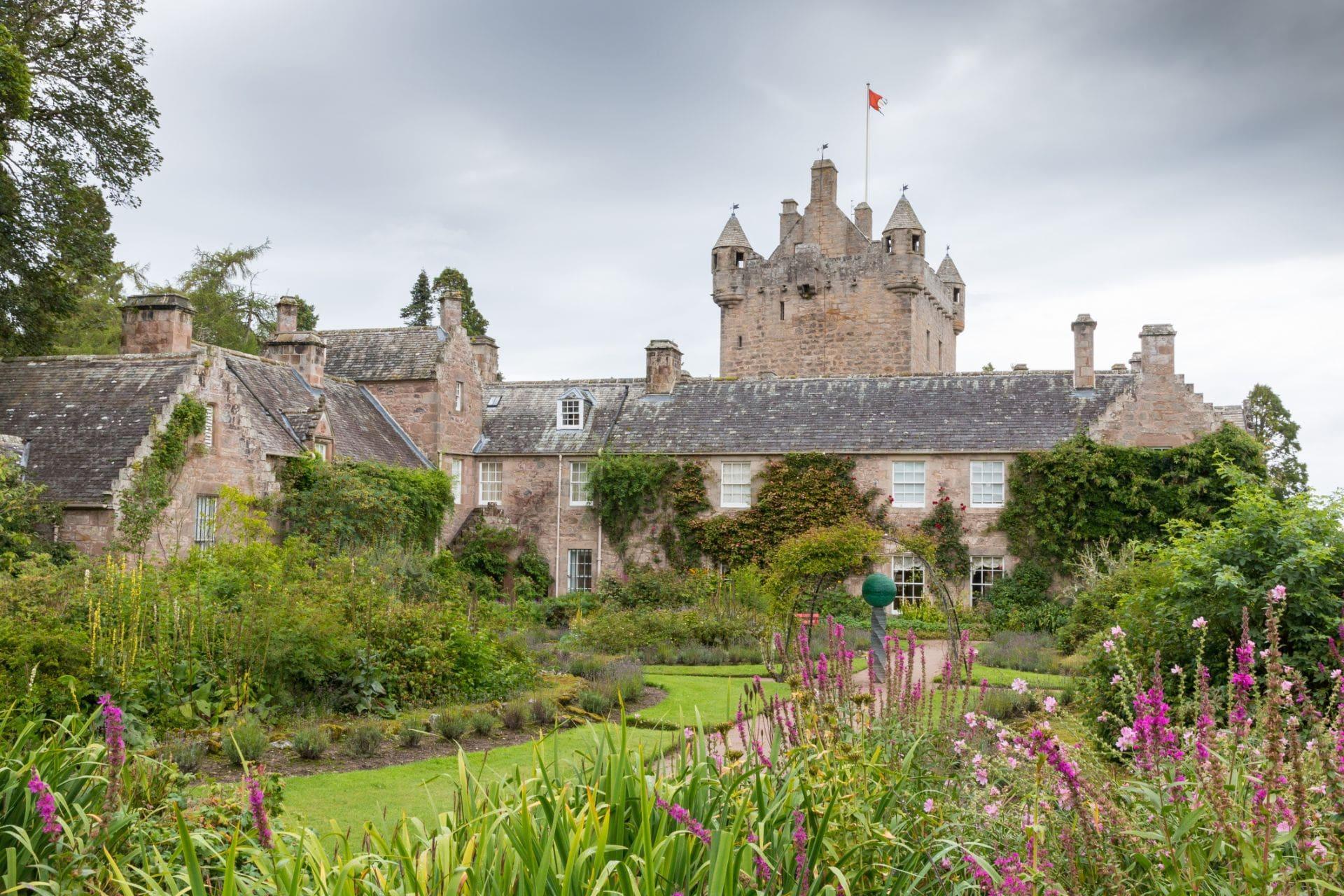 garden-full-of-pink-flowers-behind-cawdor-castle